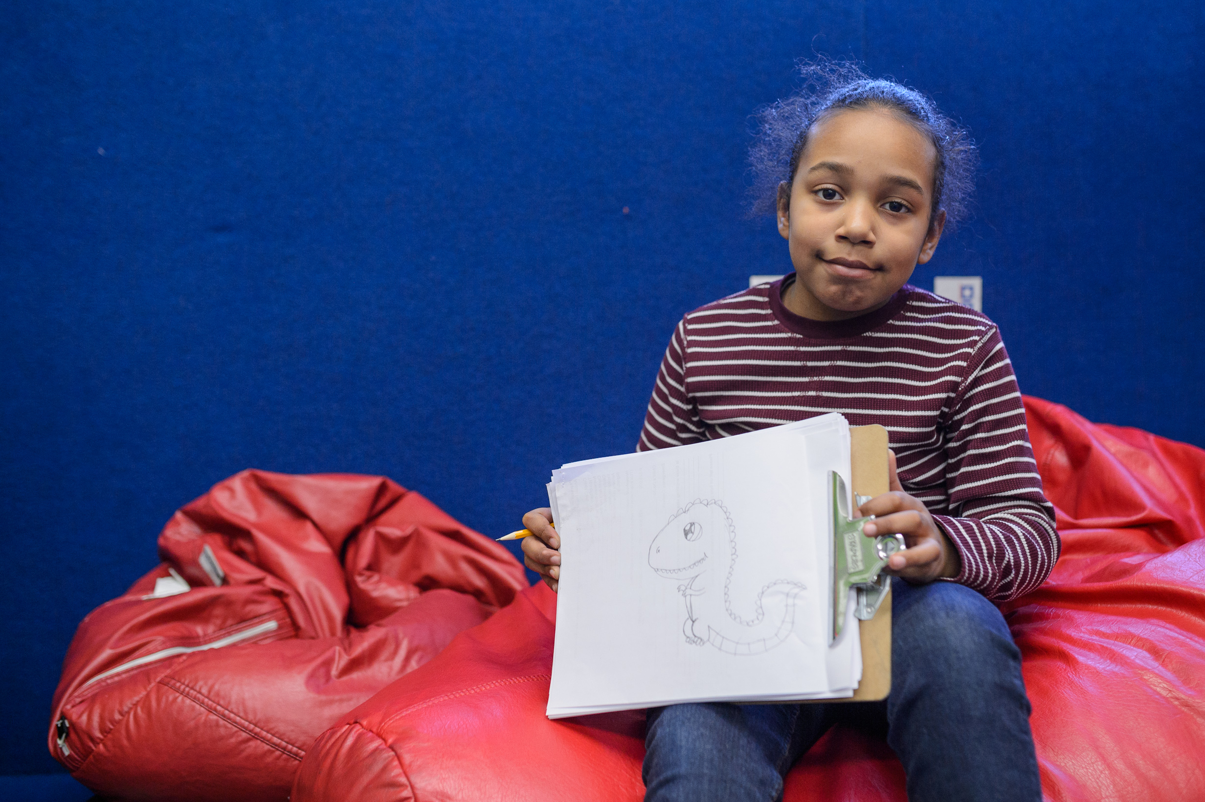 Young child shows off cool art drawing