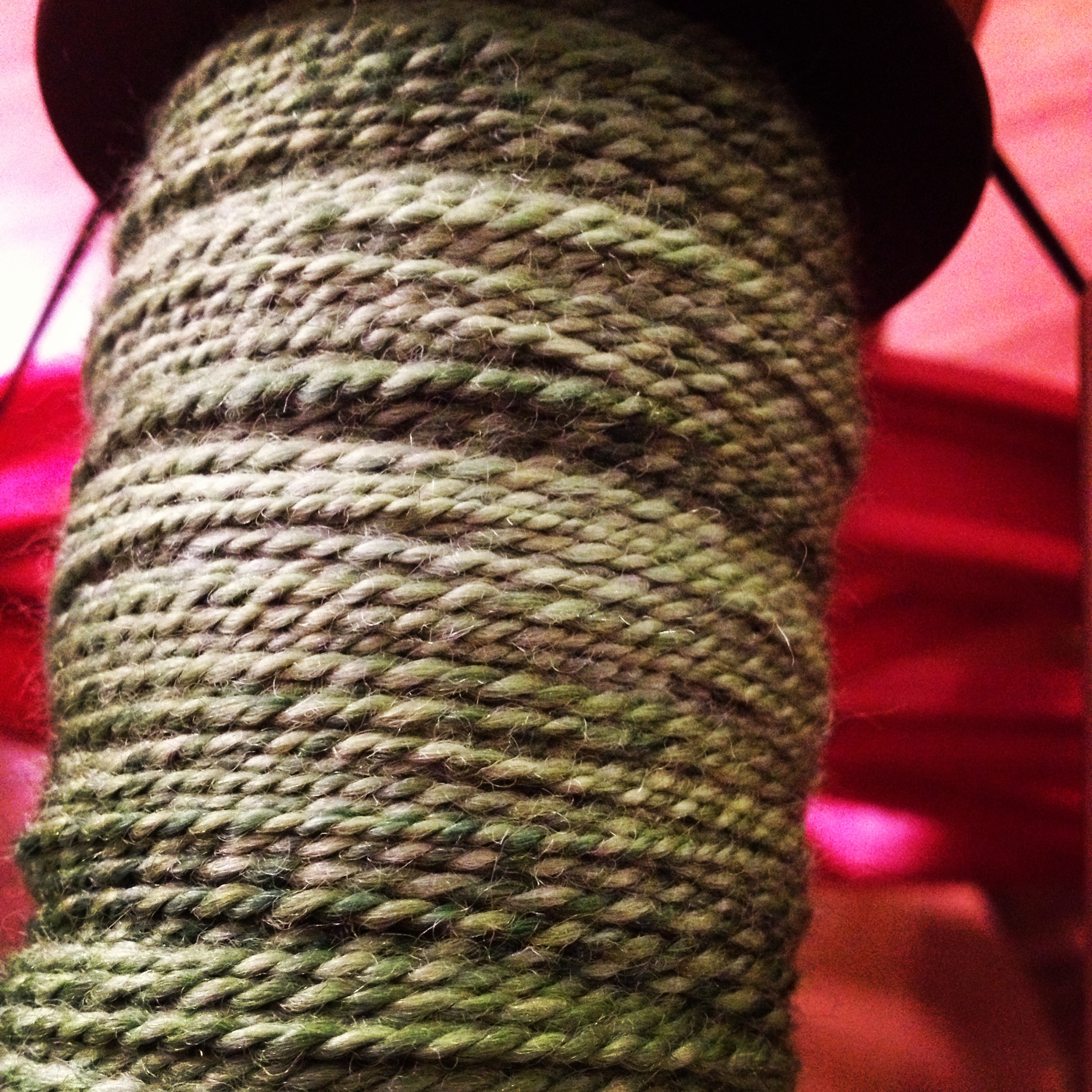 Day 7 - Plying the green singles from the day before.  My niddy-noddy is still in Parry Sound so I can't measure it yet, but I will be home this weekend so I can get it skeined and washed.