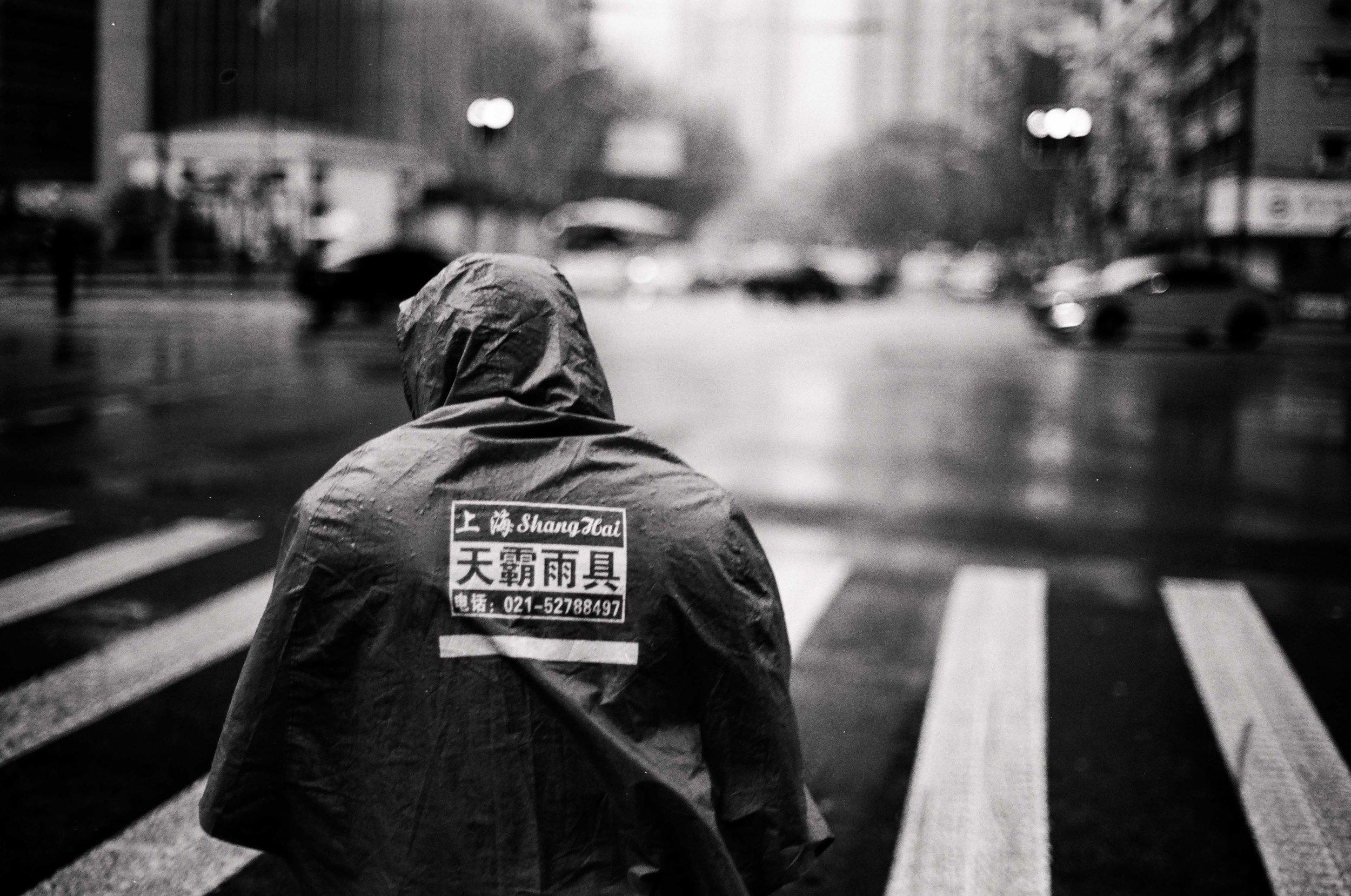 Biking in the Rain // Shanghai, China // 35mm B&W Film // 2014