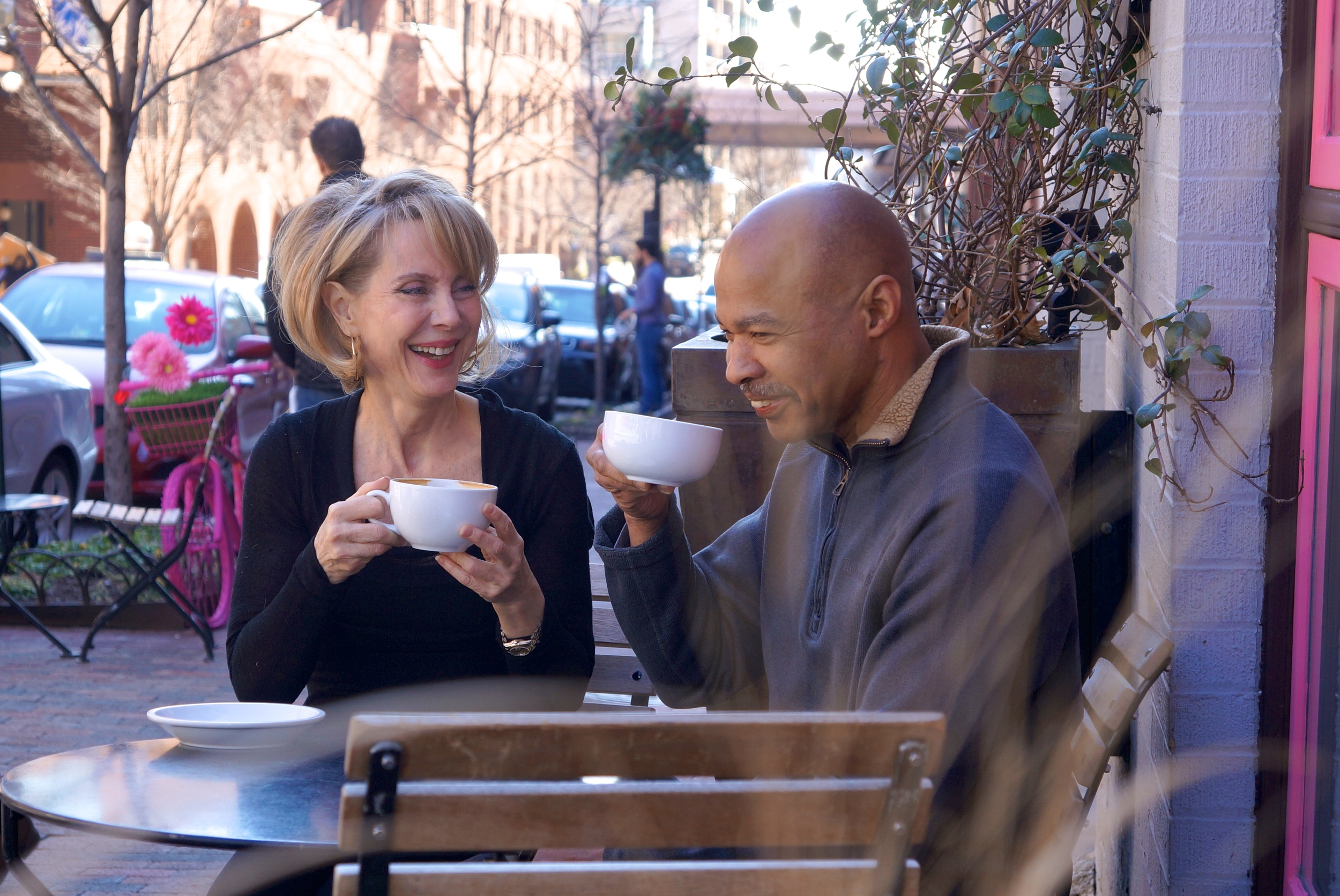 Katherine and Earl enjoying lattes from Definitions' neighbor Baked and Wired