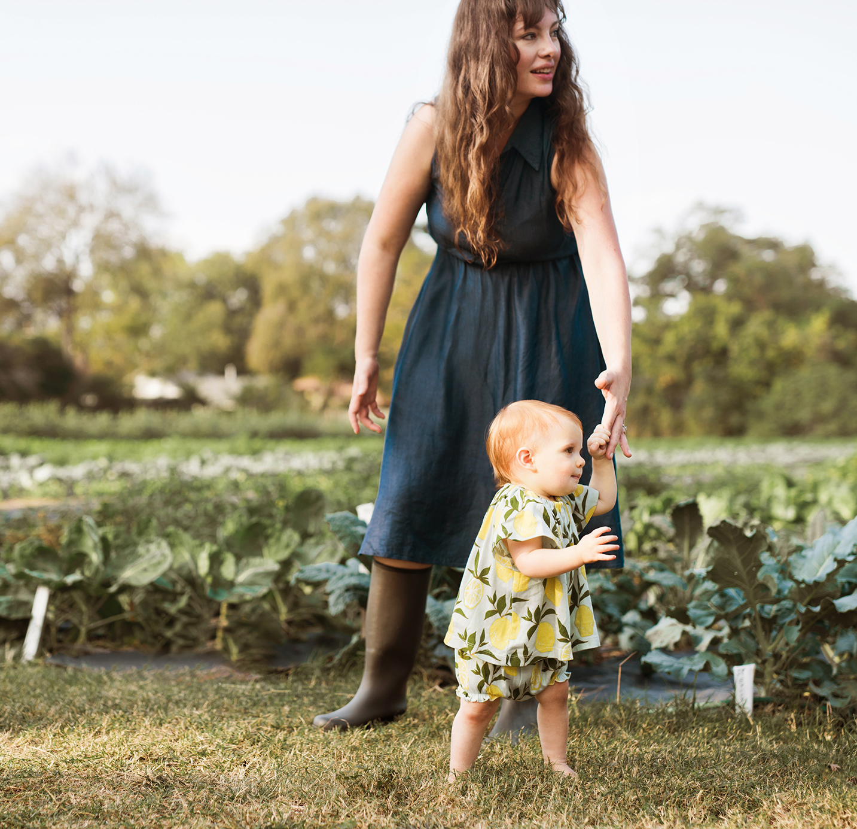 mom and baby in garden milkbarn.jpg
