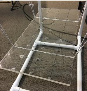 Figure a. free-free suspension of plexiglass board