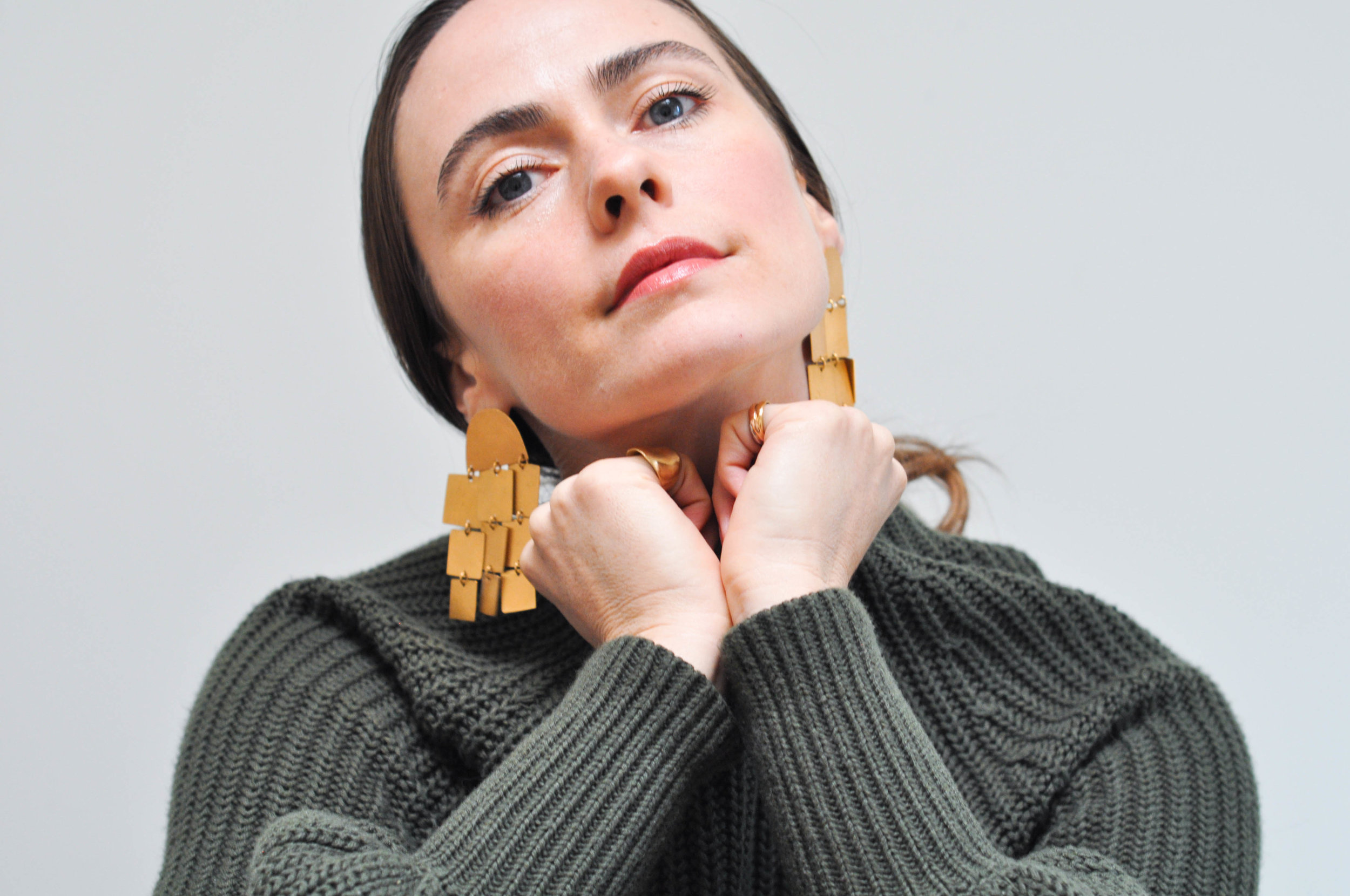 free-and-native-Cube_earrings_green_sweater_rings_pony_tail_1 (1 of 1).jpg
