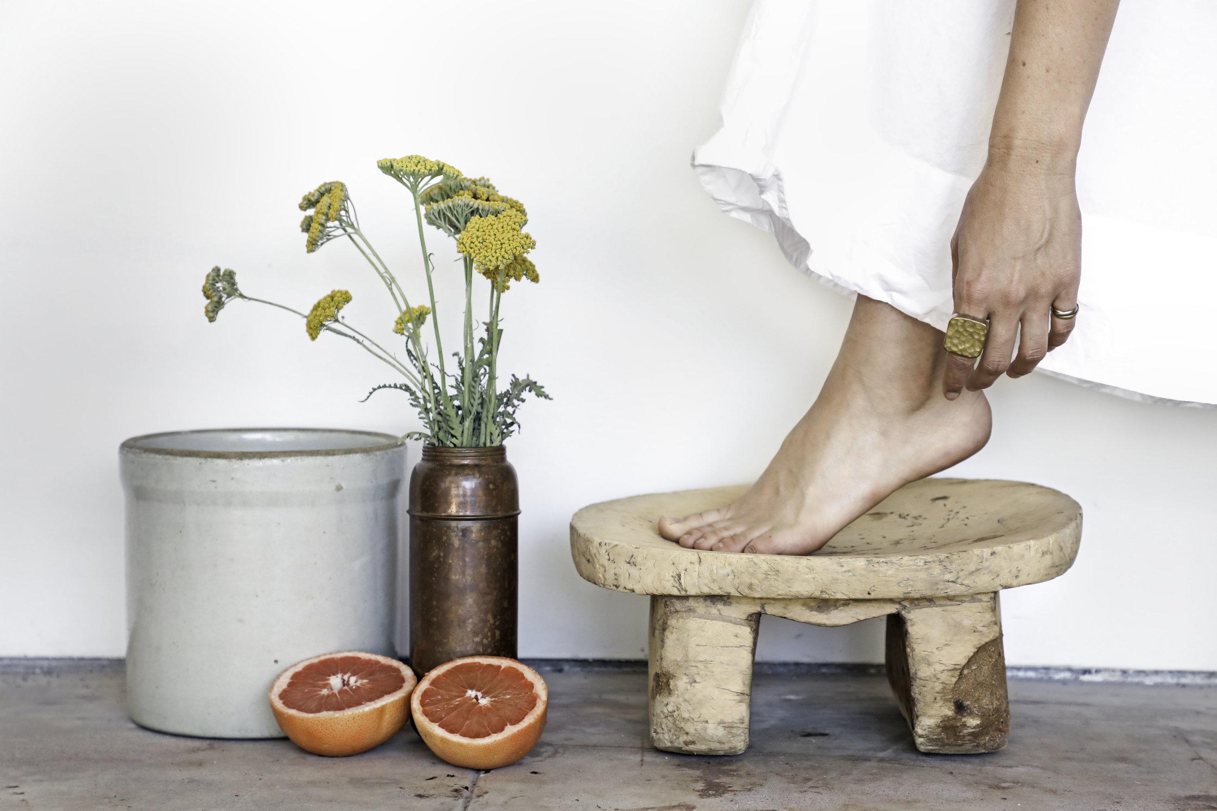 to-be-magnetic-orange-flowers-feet-stool