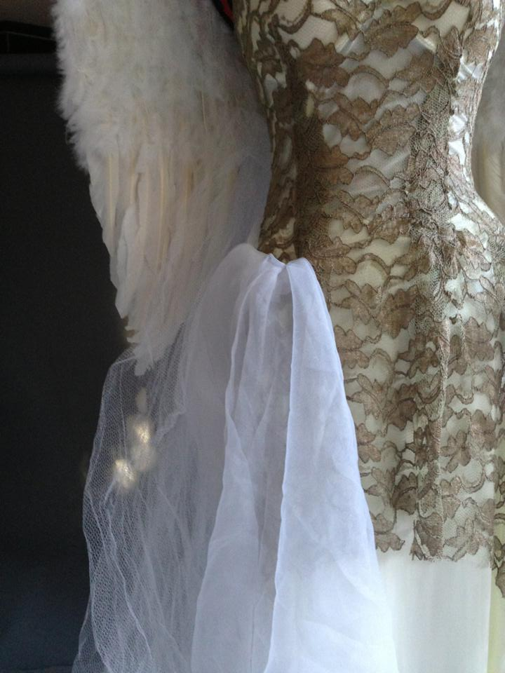 The dress I made for the shoot, lace over satin and tulle.  The wings are a symbol of flight and freedom, white being pure and gold being precious.