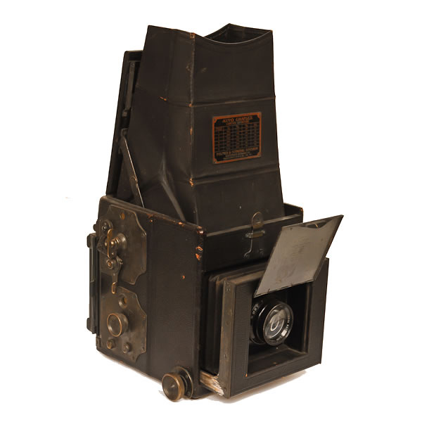 """Kodak Auto Revolving Back Tele Graflex   1915-1923. This was a very popular camera that allowed the user to take horizontal or vertical pictures without moving the camera. One only needed to depress a button on the back of the camera and then turn the film back, hence the name """"Revolving Back"""". Made by the Folmer & Schwing Department of Eastman Kodak Co., the camera had 3 advantages for its time. It used a reflex viewing system which allowed accurate focus, a multiple speed focal plane shutter (up to 1/1000 sec.) and a film holder design that facilitated the use many types of film."""