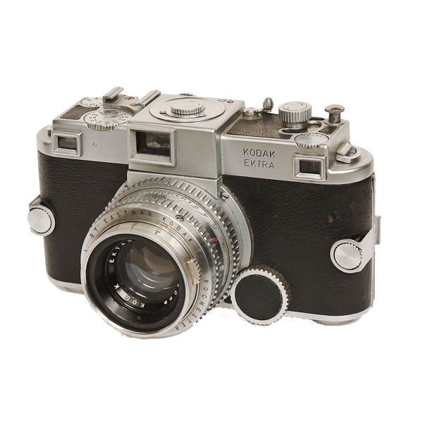 Kodak Ektra   1941-1948. A 35mm rangefinder camera, the Ektra was loaded with bells and whistles and steel. It was very heavy at over 2 lbs. It had interchangeable lenses and magazine backs. It had a focal plane shutter that went up to 1/1000 sec. This camera was part of the antique camera collection acquired from Bernie Boston.
