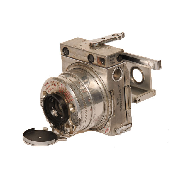 """LeCoultre Compass   1937. Manufactured by Jaeger LeCoultre & Company for Compass Cameras Ltd. of London, the Compass measures 2 3/4 x 2 1/8 x 1 1/4 and weighs 7 3/4 ounces. It has a coupled rangefinder, built in lens hood and filters. The view finder converts from normal to right angle. You can overlap 2 frames to take a panoramic picture. Originally designed as a plate camera, there is an accessory roll-film pack which holds a short roll of six 24x36 negatives. The Compass has a rotary shutter with a speed range of 4 1/2 seconds to1/500. There is also an optional folding tripod.  All this was design by a one time member of the British parliment, Noel Pemberton Billing. Billing was a jack of many trades. In his youth in South Africa he joined the mounted police, boxed competitively and fought in the Boer War. He was very interested in aviation, getting his pilots license, designing and building airplanes in his own aviation firm. He held a seat in the house of commons from 1918 to 1923.  Publishing his own journal """"The Imperialist"""" he led a campaign against homosexuality. He then renamed his journal """"Vigilante"""" and continued writing articles against people he thought were lesbian. Later he wrote a play """"High Treason"""" which he filmed. It was not successful.  As for his inventions, there was his camera, a recording system meant to record much more on each record than ever before and another camera """"The Phantom"""", a spy camera which never went into production."""