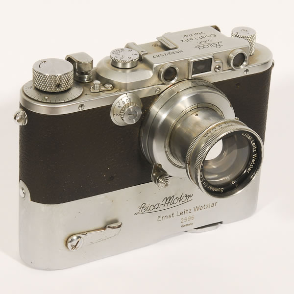 """Leica 3C Molly   1940-1946. Made during WWII the quality of the chrome plating was not as good because of the cost of the process. Hence these models didn't hold up as well to regular use. The attached motor drive named the """"Mooly"""" was the first motor drive ever produced."""