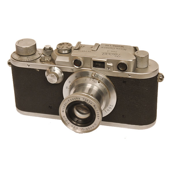 Nicca 3   1949. Seven years after their first camera and 1 year after manufacturing cameras under the Nicca name, the former employees of the Seiki Kogaku company (predecessor of the Canon Company) came out with the Nicca III which looked a lot like a Leica III  The Nicca company made cameras for Sears under the Tower name and in 1958 they were absorbed by Yashica.