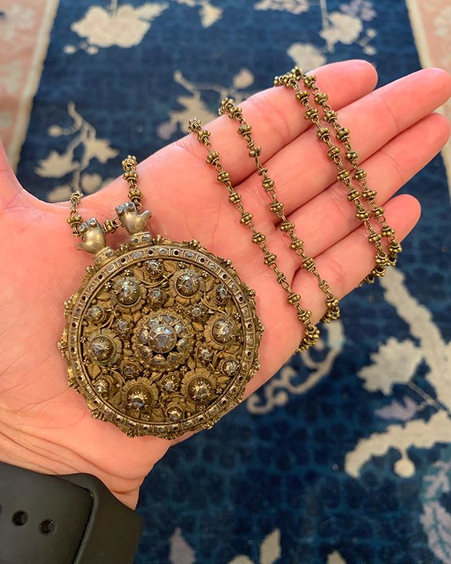 Long & lovely diamond-set sautoir suspended from a matching chain long enough to wrap yourself up in multiple times - handmade in the Middle East in the 19th century, its design echoes a culture rich in age old symbols & motifs - note the hands on the the pendant 'hanging onto' the chain - I love that touch of whimsy and history!  Bohemian jewelry at its best, wearable any day, any way . Available for sale . #vintagejewelry #antiquejewelry #sautoir #necklace #jewelswithstyle #forsale #robinkatzvintagejewels