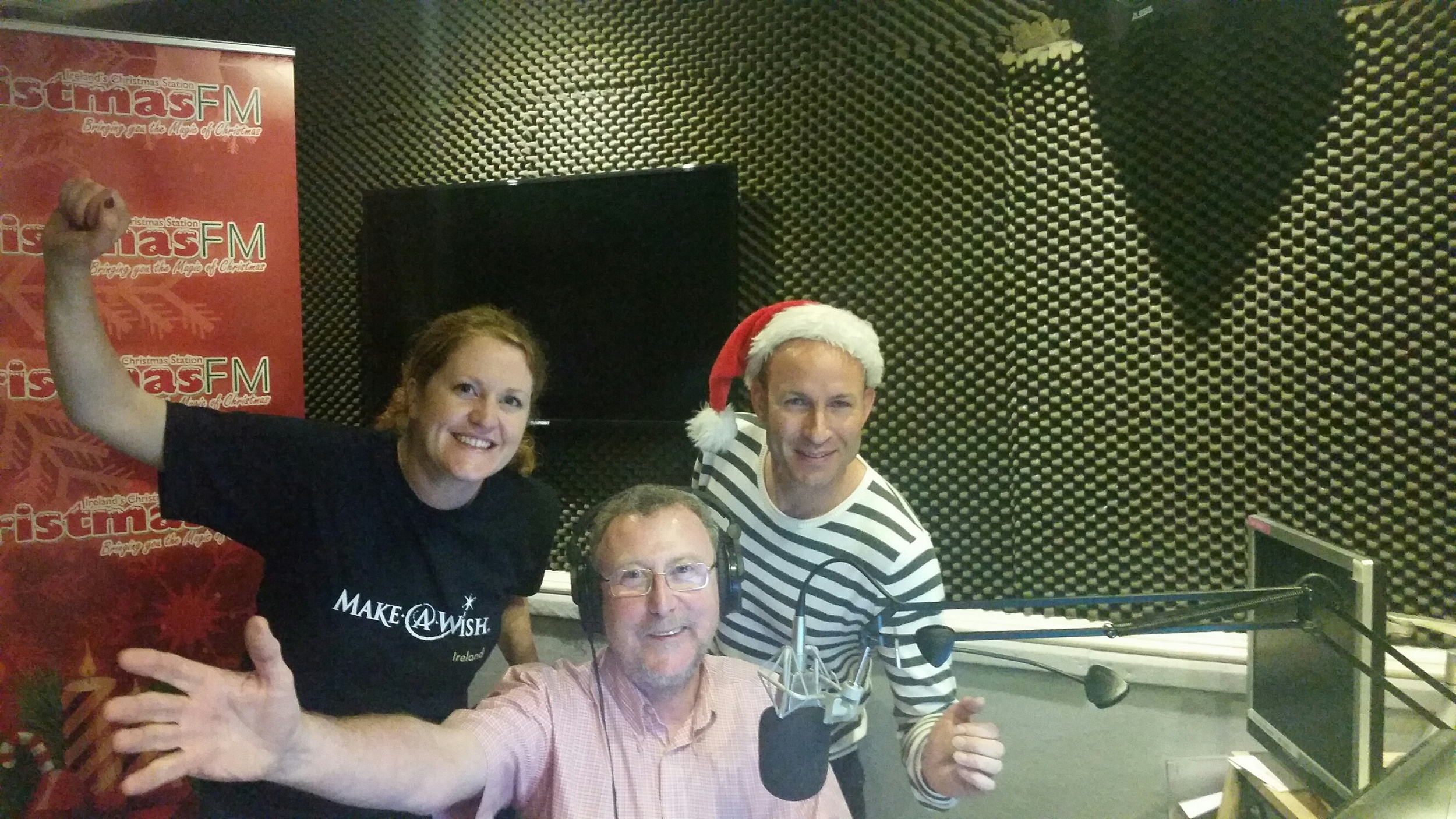 Garvan Rigby (in the hat!) with Make A Wish Ireland and Christmas FM in the studio.