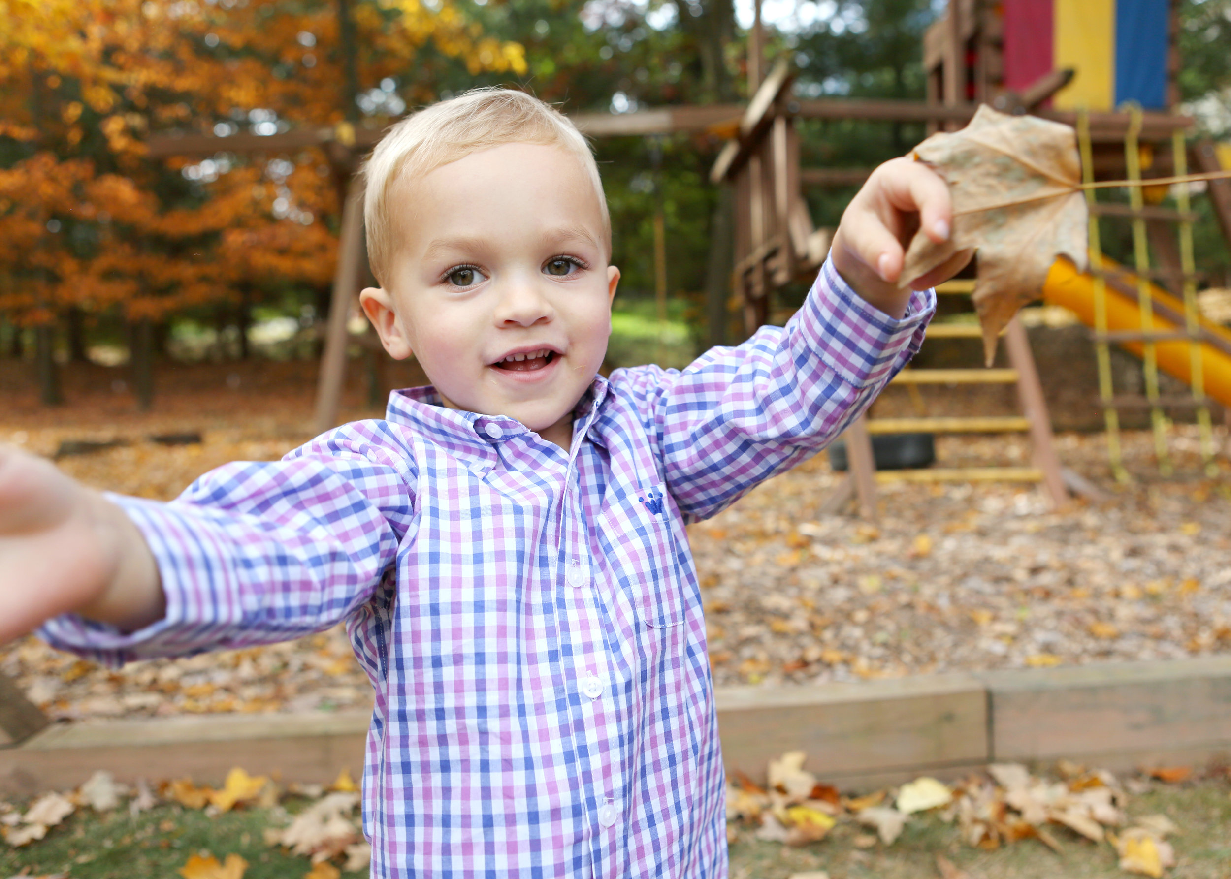 NJ and NYC based lifestyle photographer | Jennifer Lavelle Photography |  children and families, newborn, lifestyle, interiors, food and travel.  Boy throwing leaves.