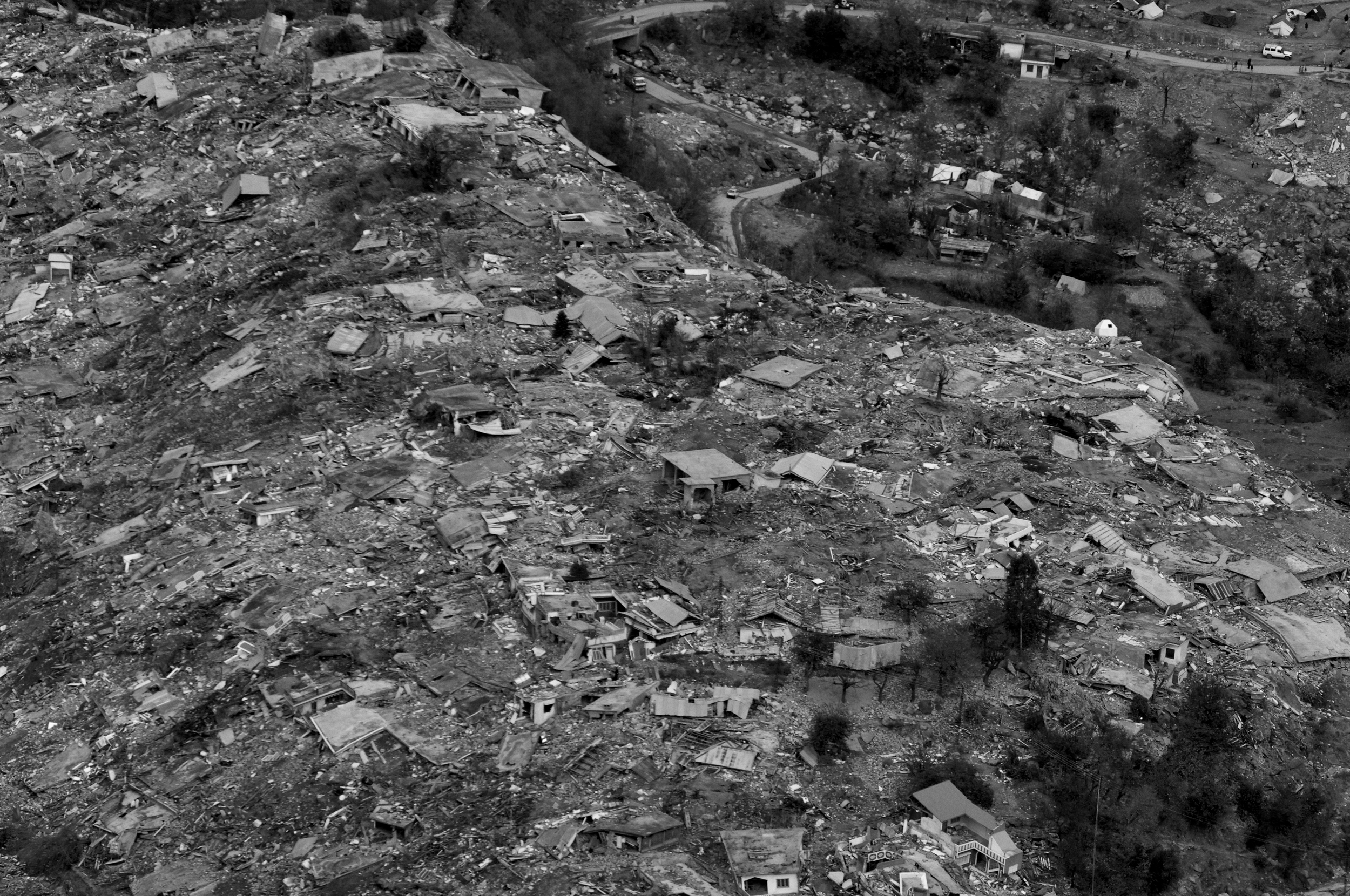 Aerial view of destroyed villages and towns around Balakot, NWFP, Pakistan, November 12, 2005. (Photo / Mark Pearson) The massive October earthquake in Kashmir affected one of the highest and most remote places on earth. Difficult terrain slowed the relief effort and the largest scale humanitarian air operations since the Berlin blockade began.