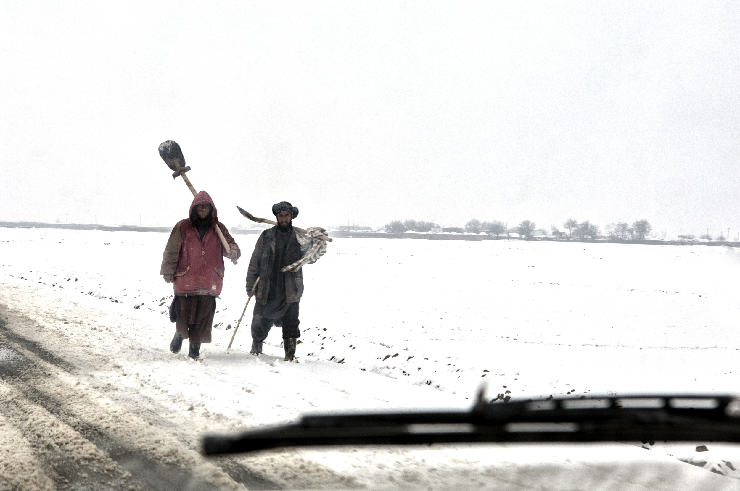 Locals carrying shovels to clear parts of the A76 in Sheberghan,  Jowzjan Province, Afghanistan, February 14, 2008. (Photo/Mark Pearson)