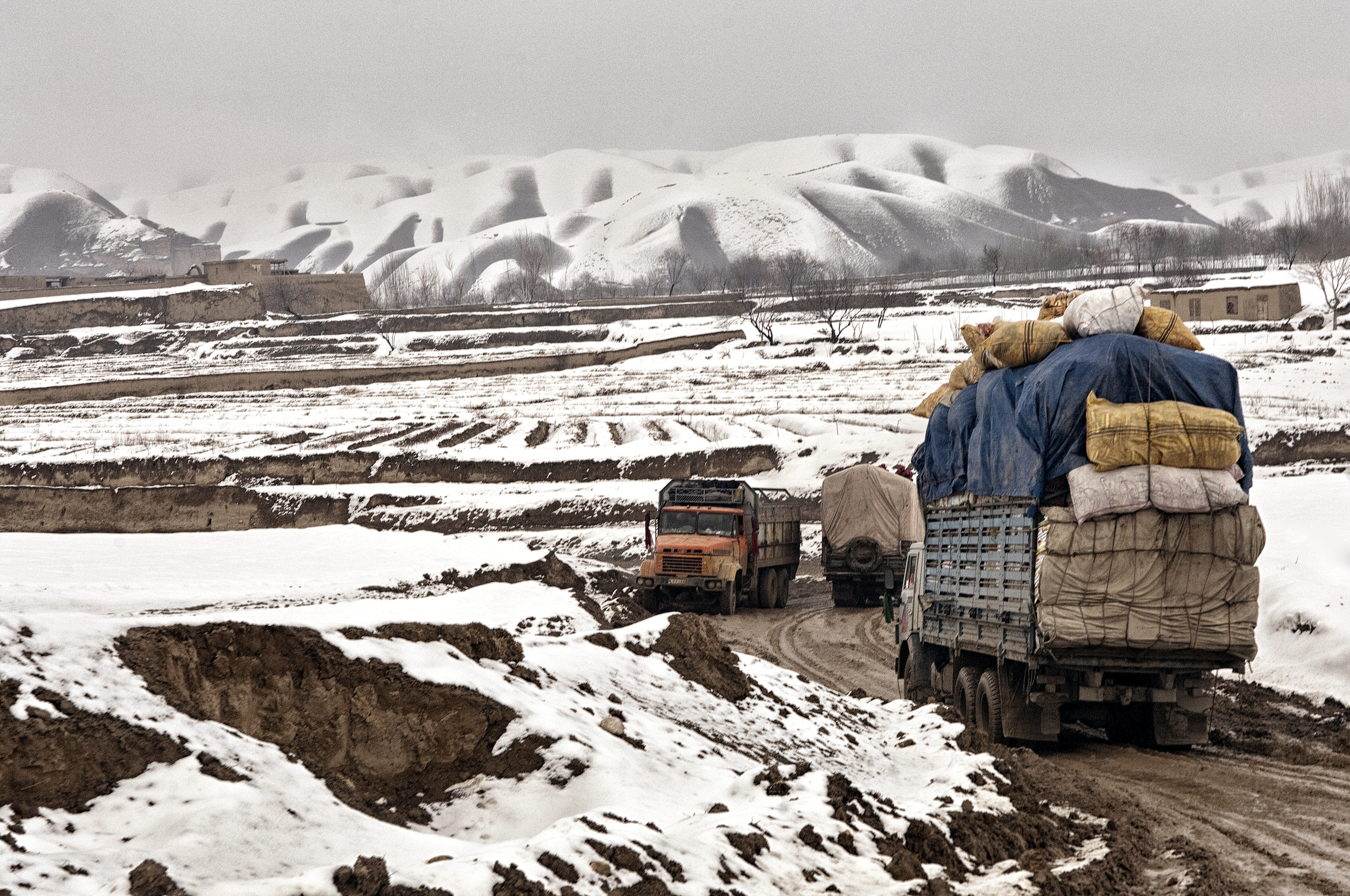 Trucks delivering delivering goods to villages cut-off due to heavy snowfall, Maymana, Faryab, Afghanistan, February 14, 2008. (Photo/Mark Pearson)