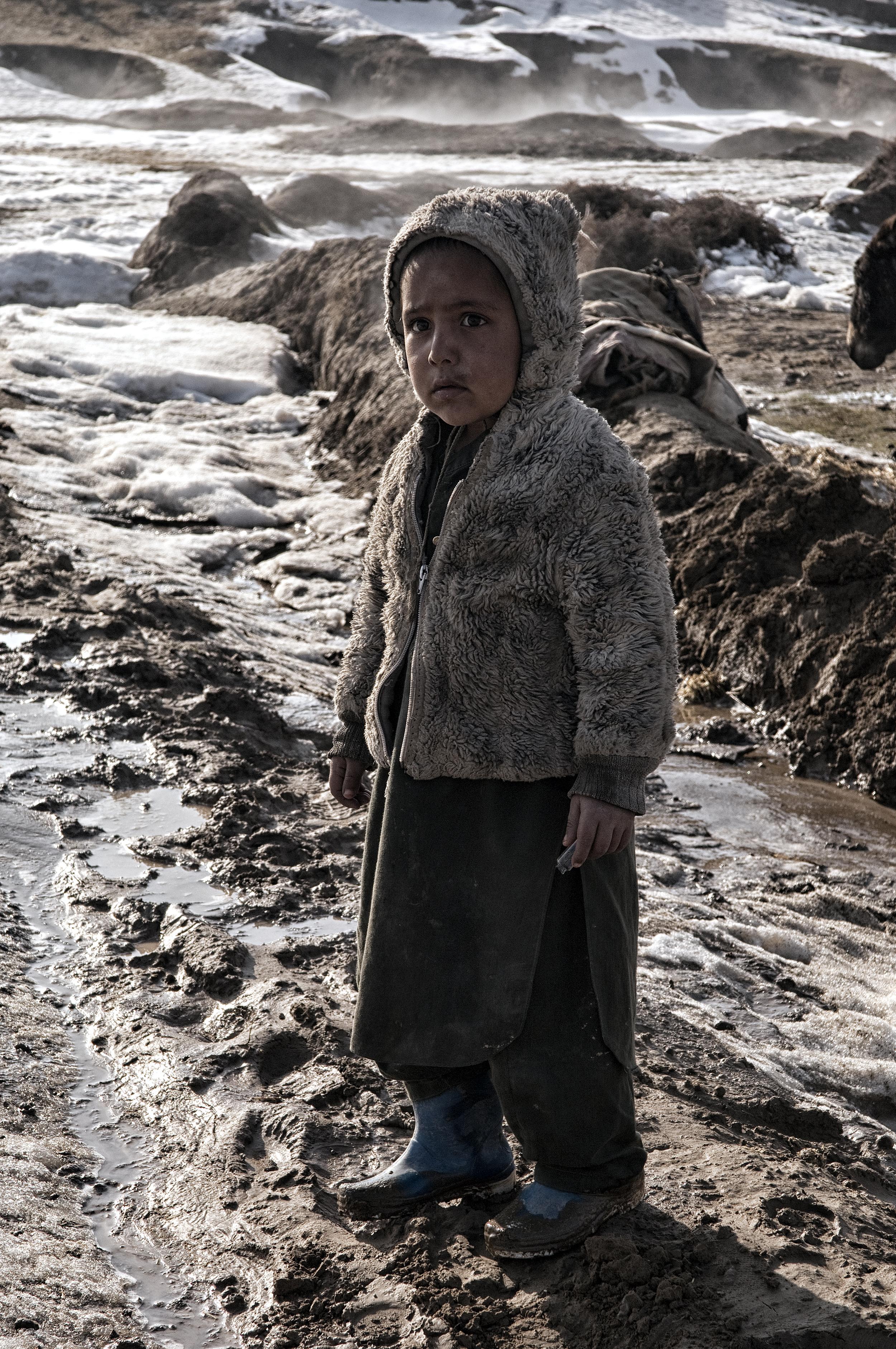 A young Afghan boy in the village of Qasabach Qala, Faryab Province, Northwest Afghanistan on Friday 15th February, 2008.