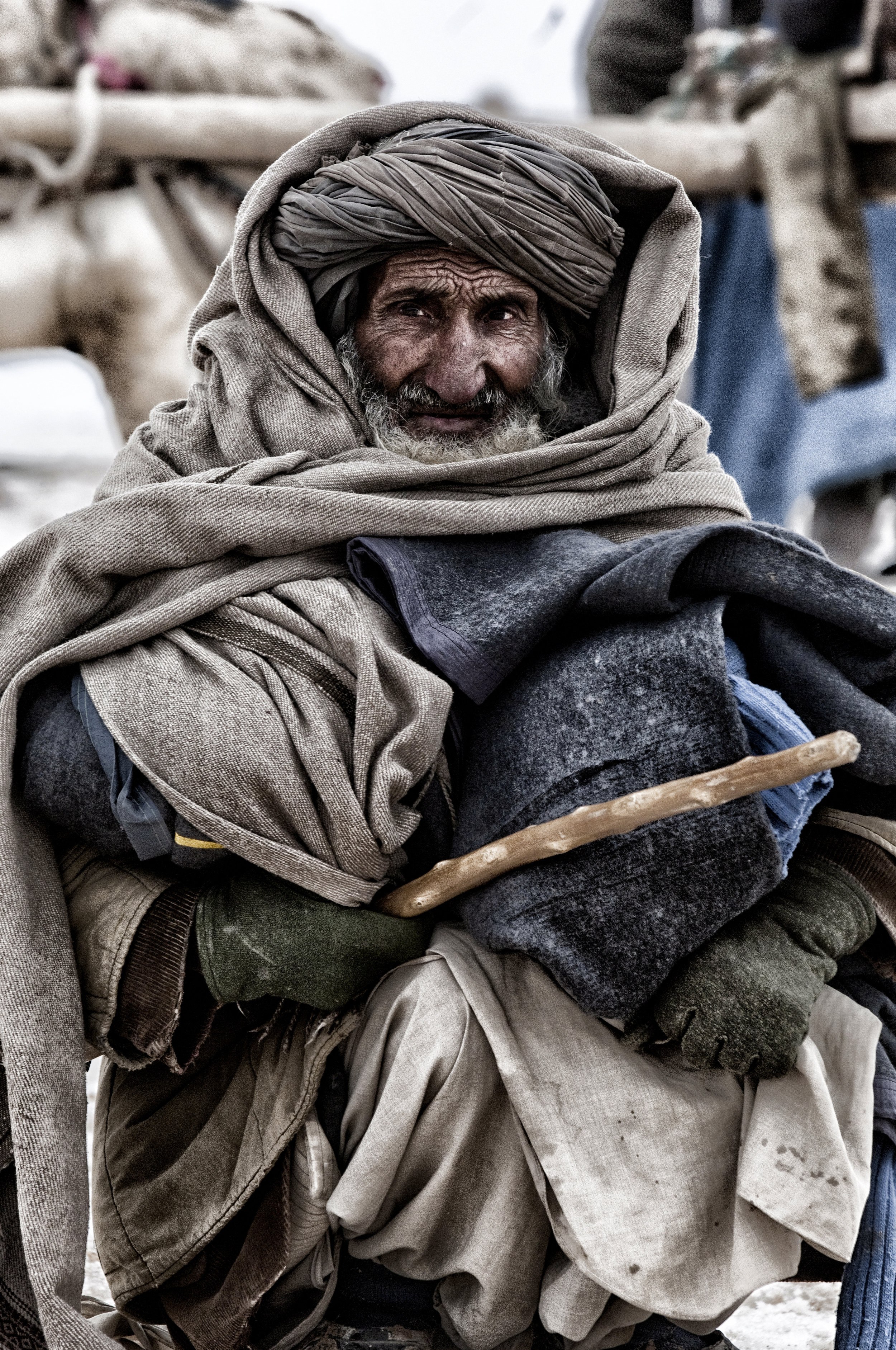 An elderly Afghan man collects winterised aid from a distribution by ACTED to a displacement camp near Pul i Khumri ,  Baghlan Province, Afghanistan, February 13, 2008. (Photo/Mark Pearson)