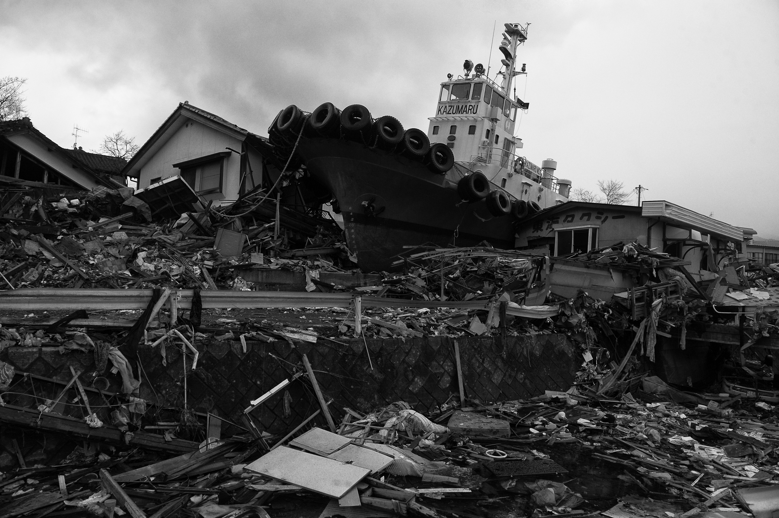 A destroyed tug boat smashed through a housing estate in Ofunato, Iwate, Japan, March 22, 2011. (Photo/ Mark Pearson) Almost all of the 29,000 fishing boats in Miyagi, Iwate, and Fukushima prefectures were rendered unusable after the 2011 Tōhoku earthquake and tsunami struck.12,000 fishing boats in Miyagi prefecture were destroyed or damaged, and at least 440 fishermen were killed or missing.