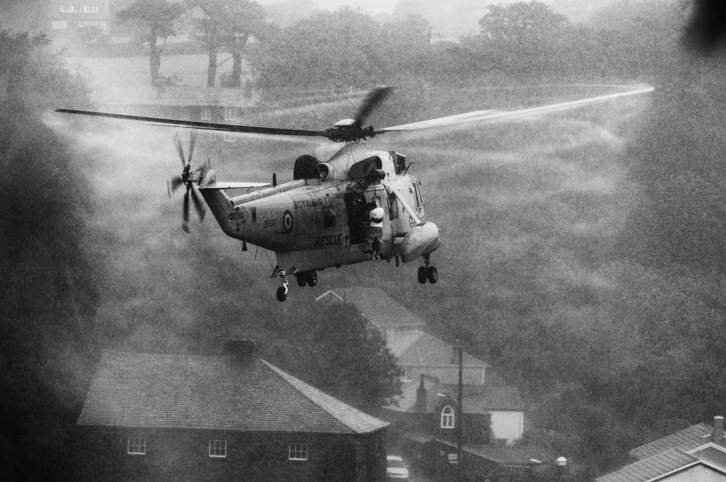 RAF Search and Rescue helicopters rescue flood victims in Boscastle, Cornwall, August 16, 2004. (Photo/Mark Pearson)