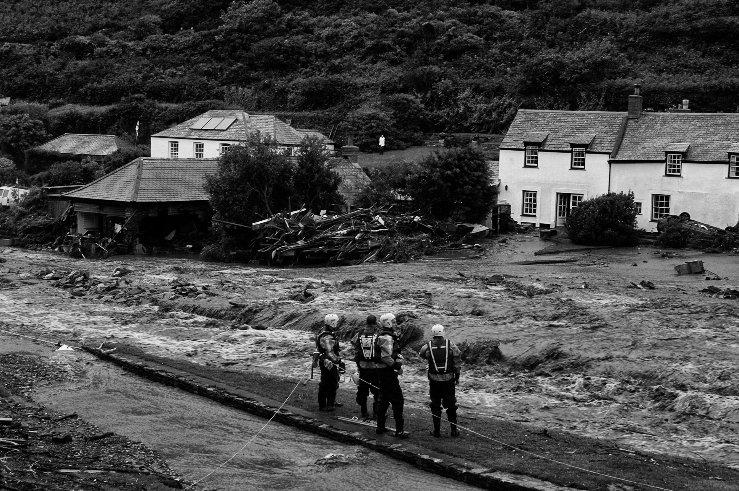 Fire brigade and the RNLI search and rescue fast rope teams looking for flood victims in Boscastle, Cornwall, August 16, 2004. (Photo/Mark Pearson)