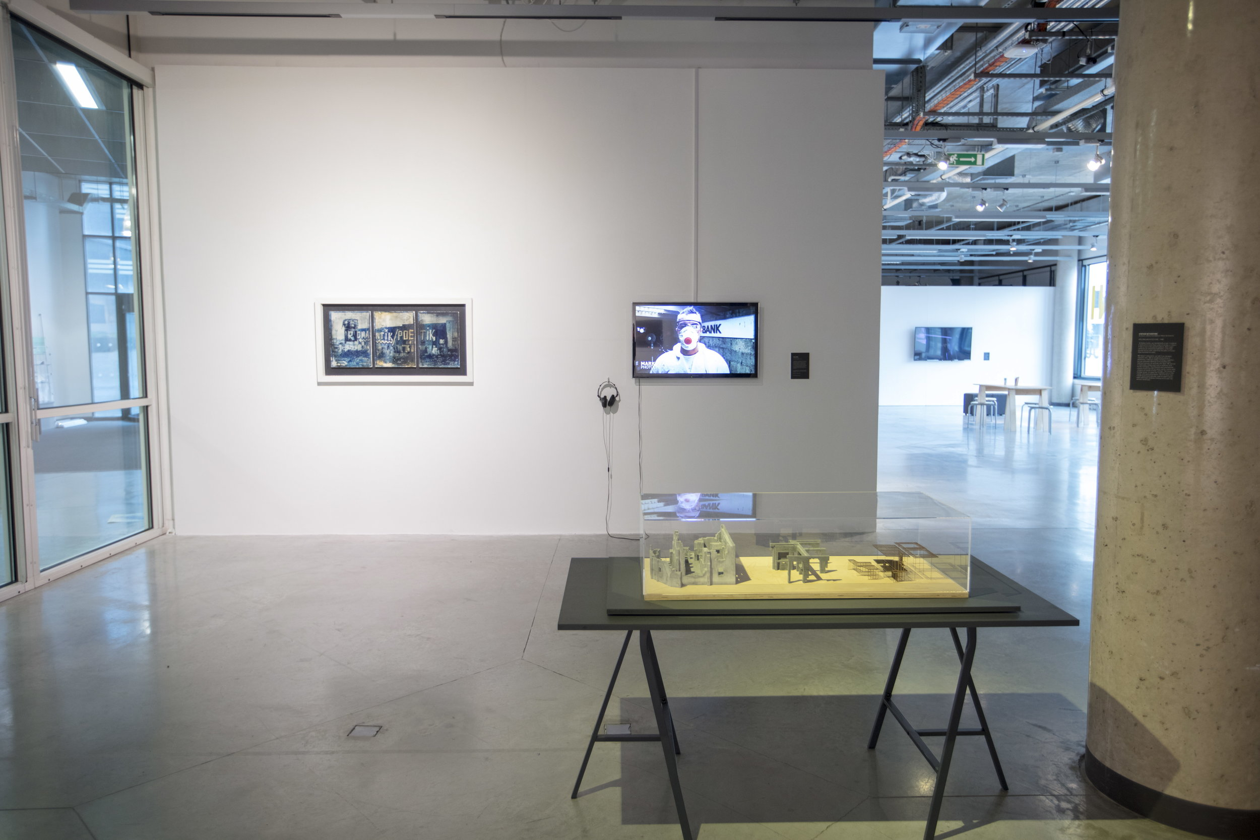 Art of Failure film running alongside the triptych on concrete at the Roland Levinsky Gallery