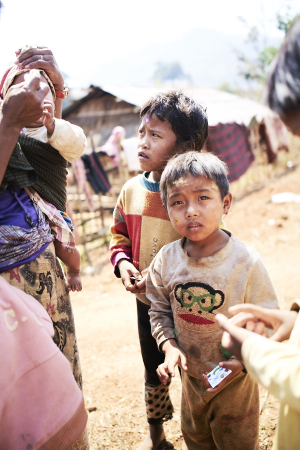 Children and their families who have fled from war and have started a new life in a village 40km away from Yangon.