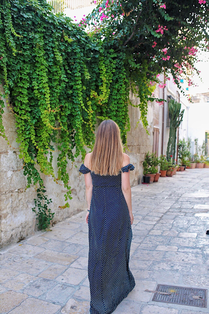 Walking to dinner in Polignano a Mare, Puglia, Italy.  Read on to find out where to eat in Puglia!