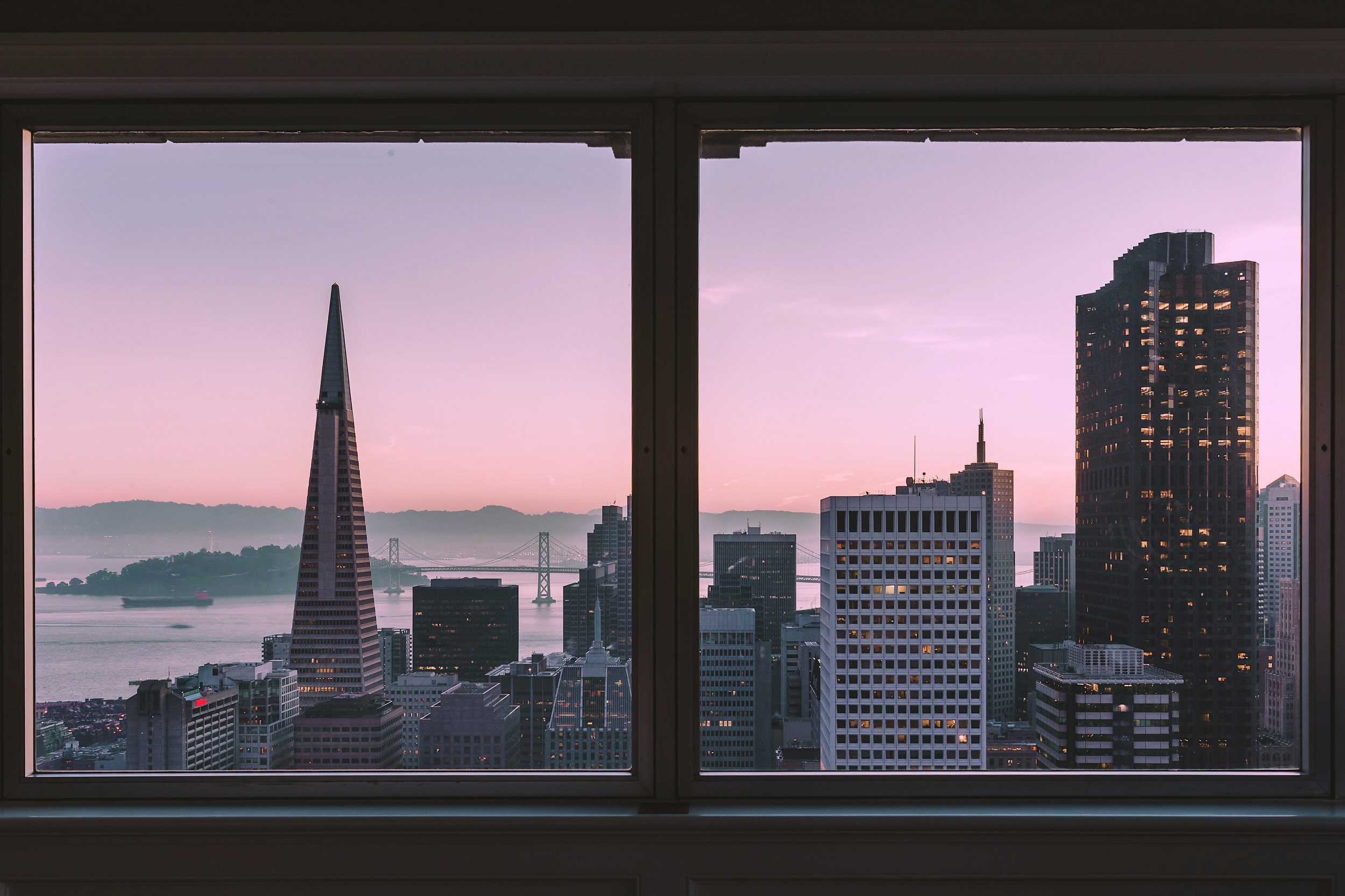 Sunrise views of San Francisco from bed in the Presidential Suite at the Fairmont San Francisco