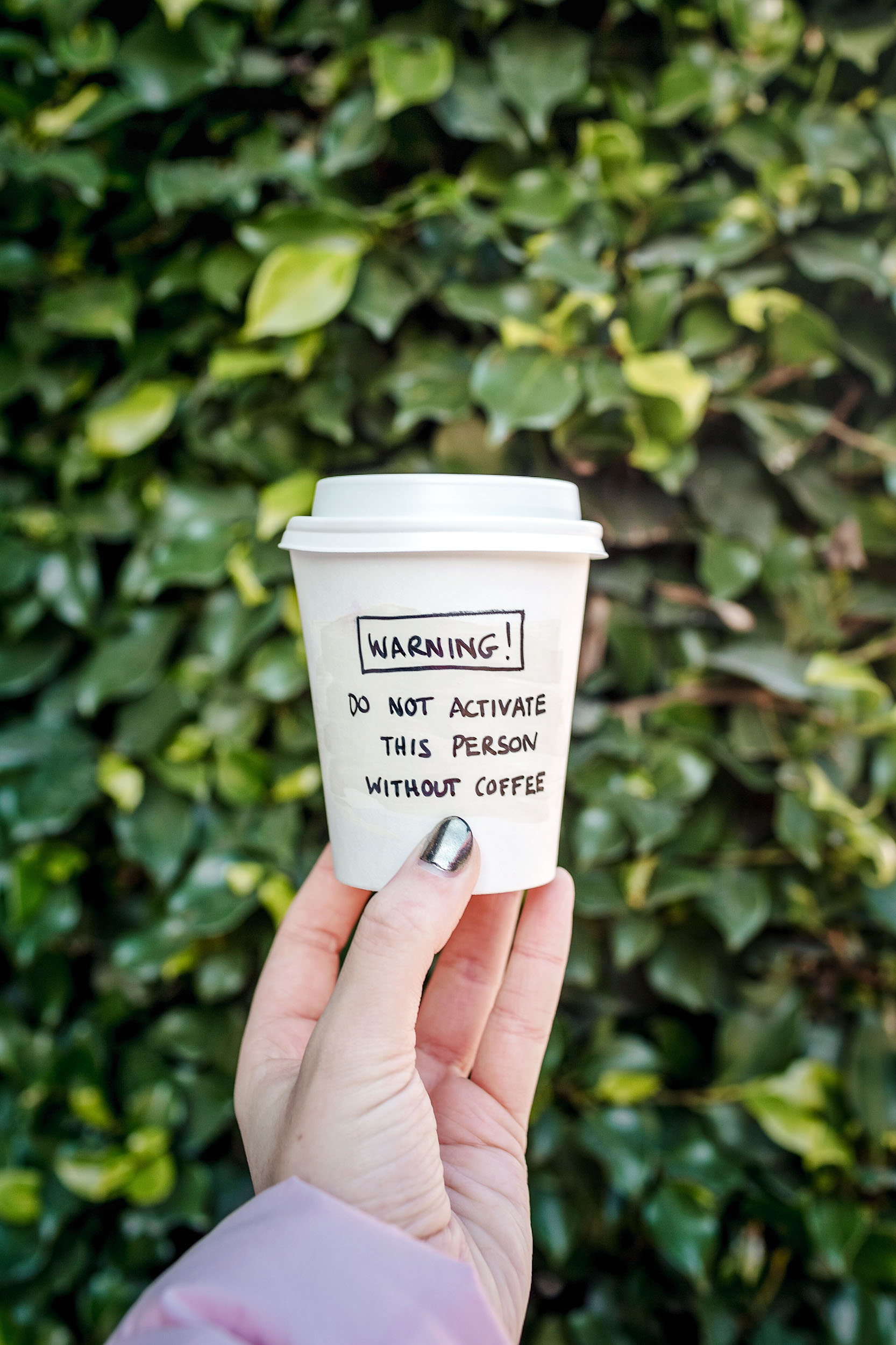 The to-go cups at Wish Slow Coffee House in Lisbon are so cheeky and fun!