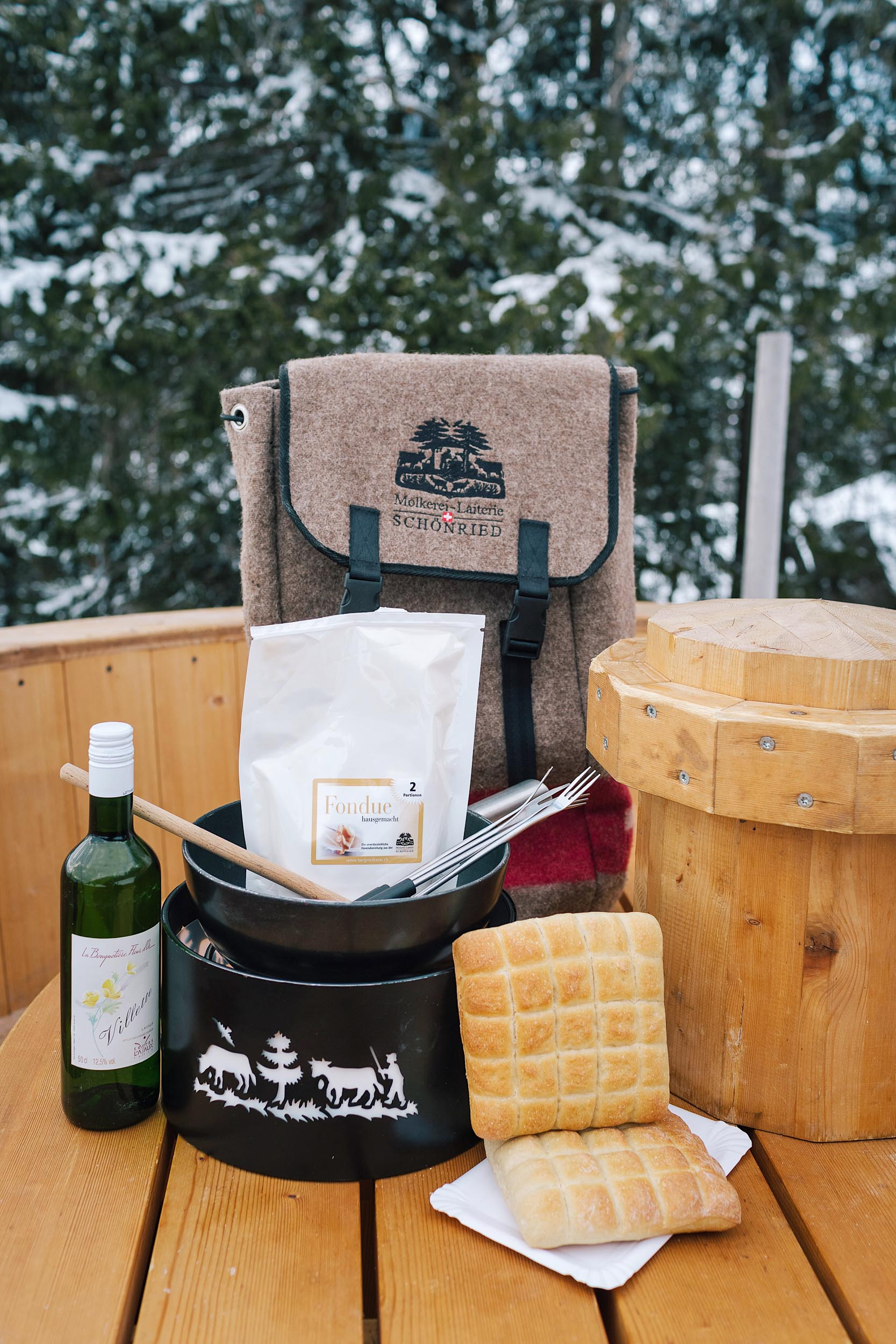 Before you start your fondue hike in Gstaad, you'll want to pick up a fondue backpack