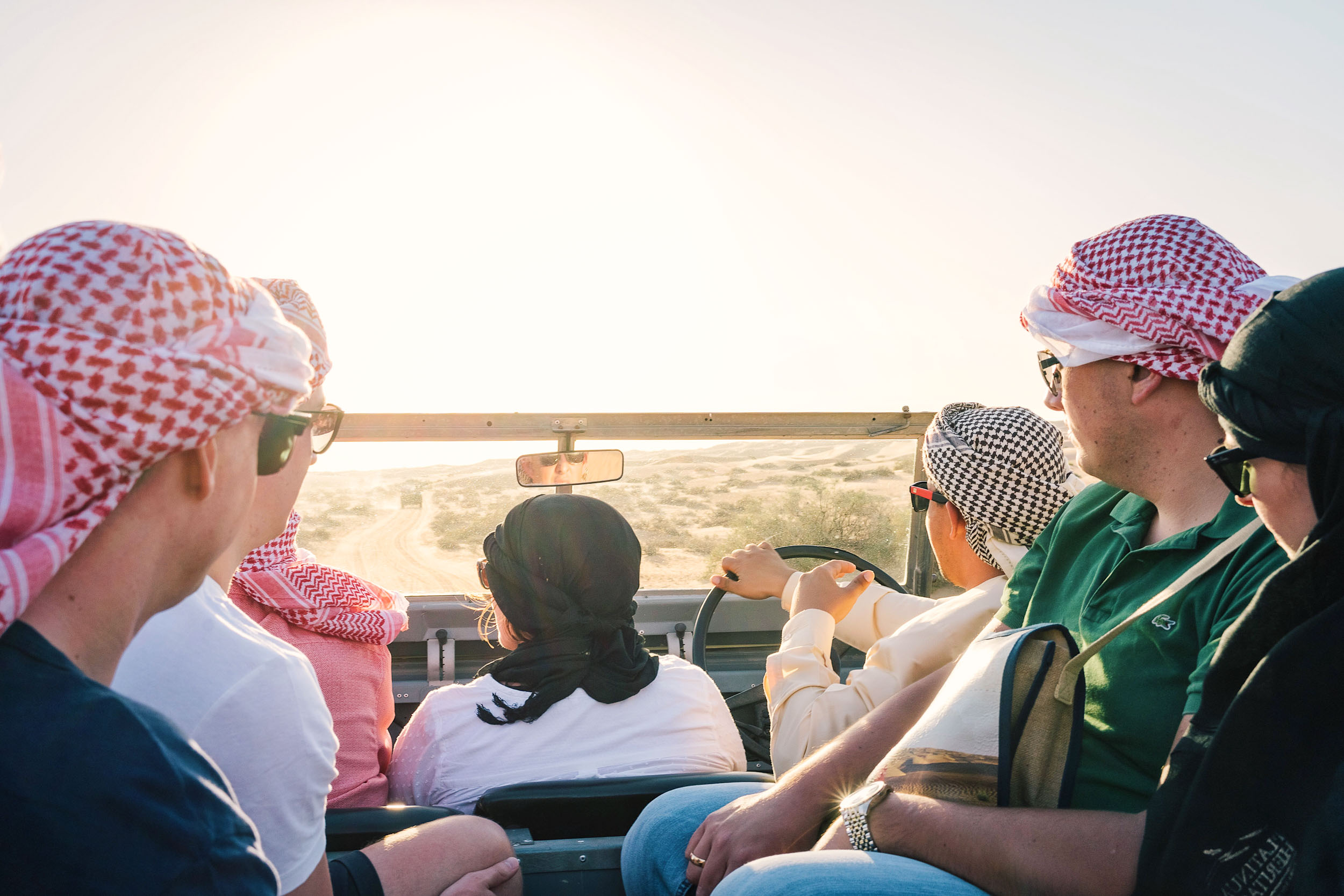 Driving vintage 1950's Land Rovers through the desert in Dubai