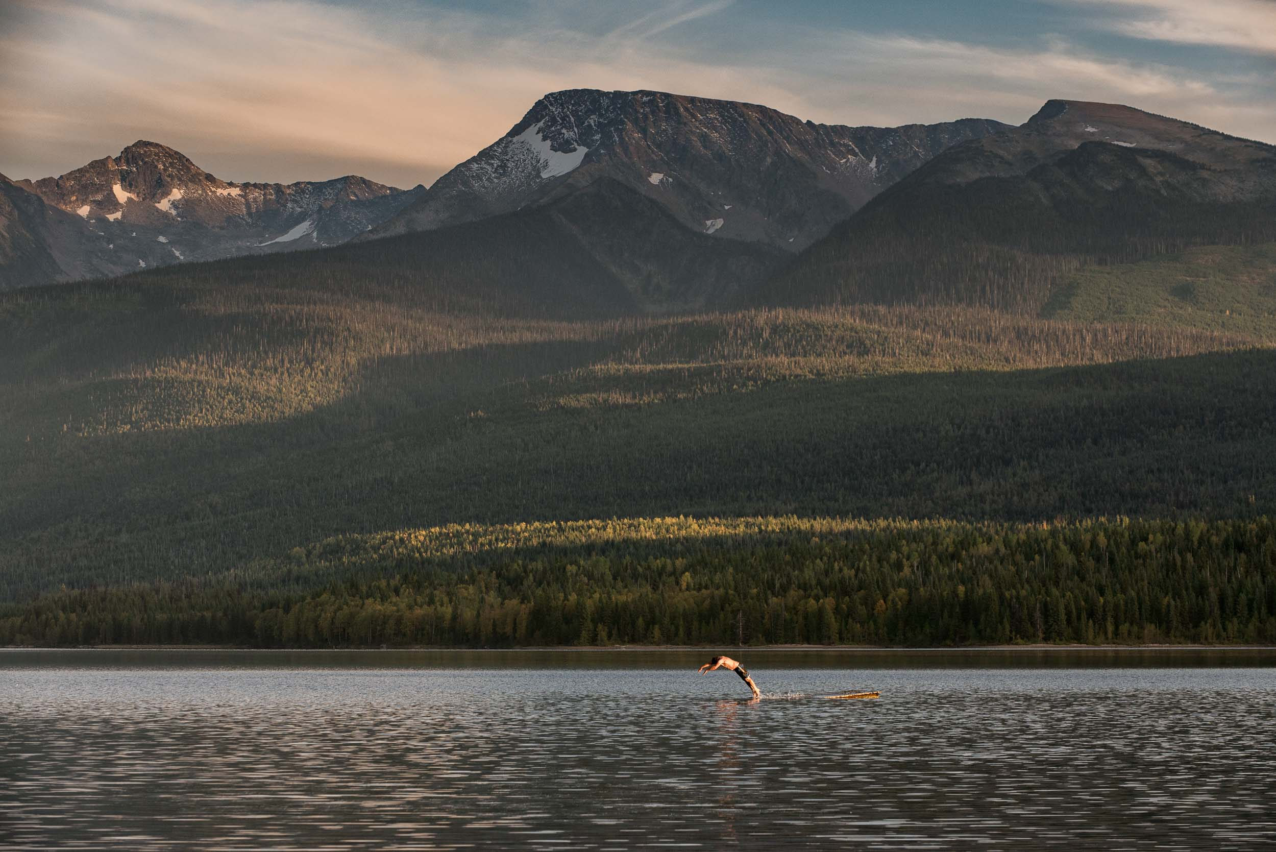 Swimming in Crooked Lake in the Cariboo Mountain range. Credit: Destination BC/Michael Bednar