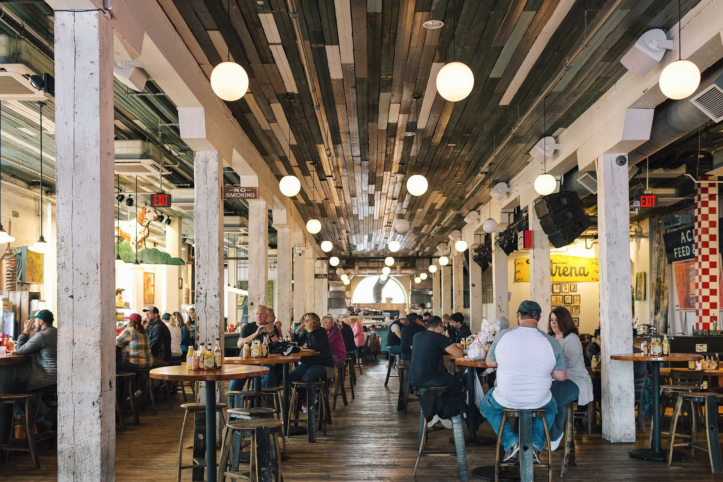 The first floor of Acme Feed & Seed a honkytonk style restaurant with food and beer to be eaten on communal tables.