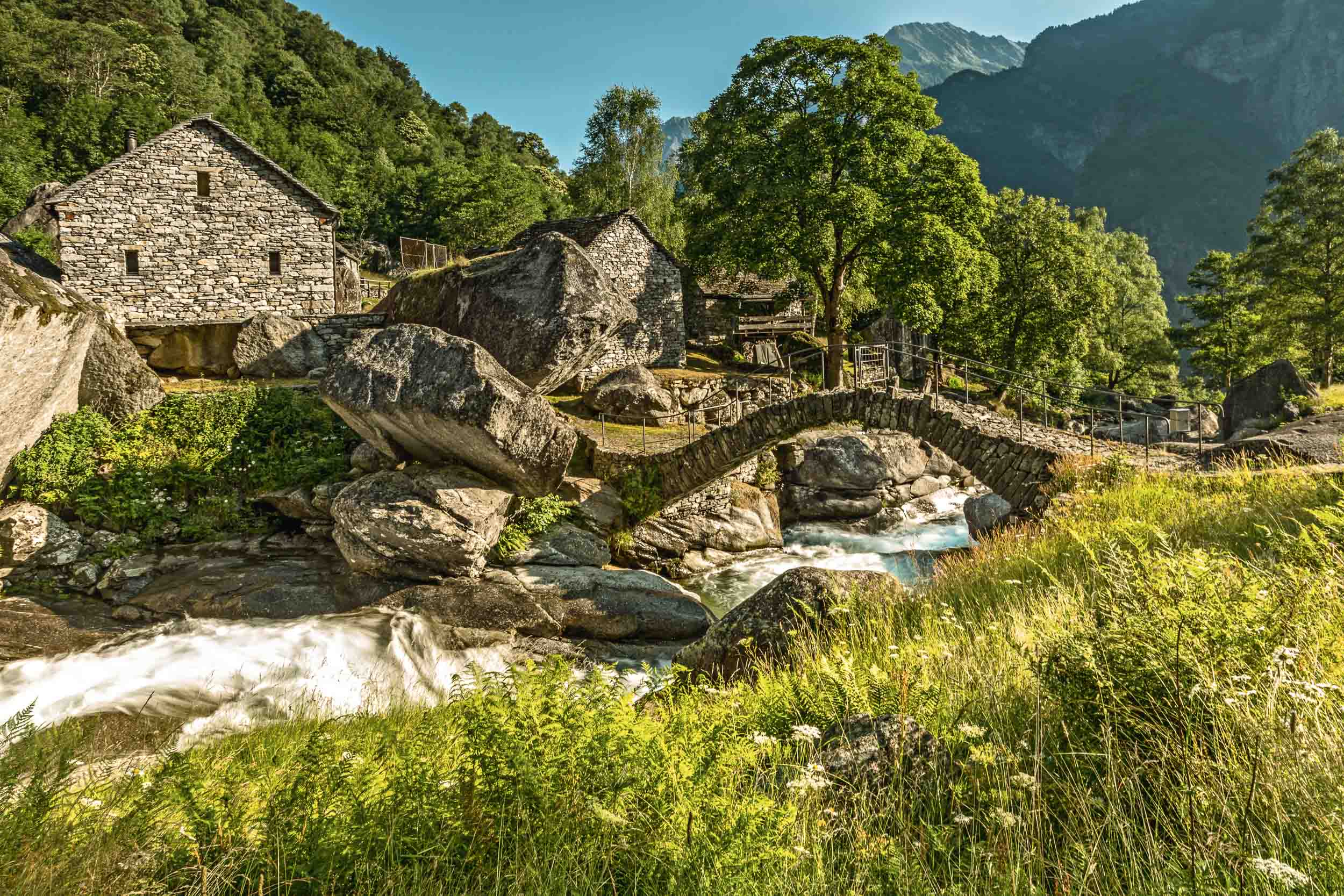 Historic bridge in Puntid, Bavona valley, Cevio.  Copyright by: Switzerland Tourism