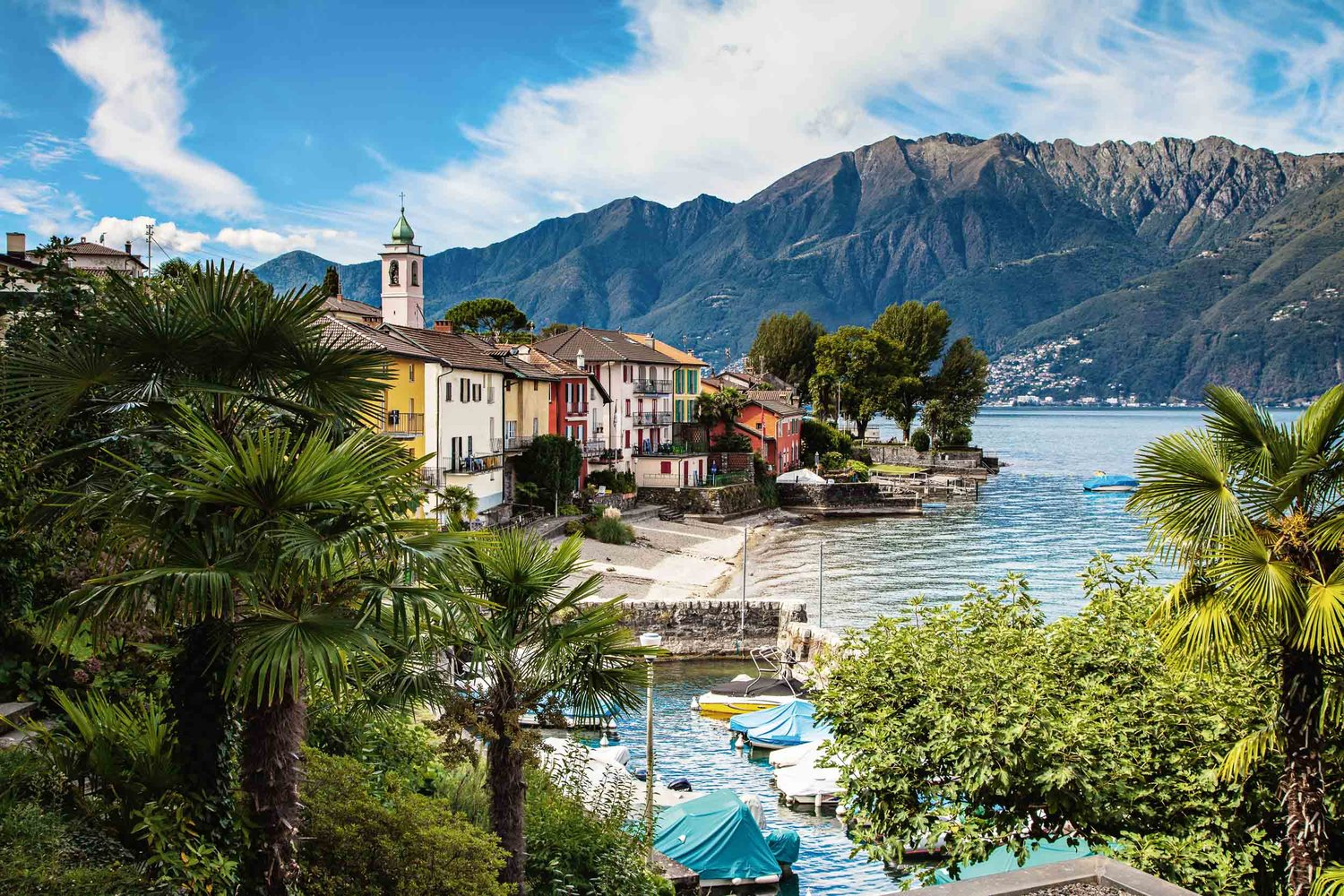 Small harbor with colorful row of houses on Lake Maggiore, Gerra (Gambarogno). Copyright by: Switzerland Tourism