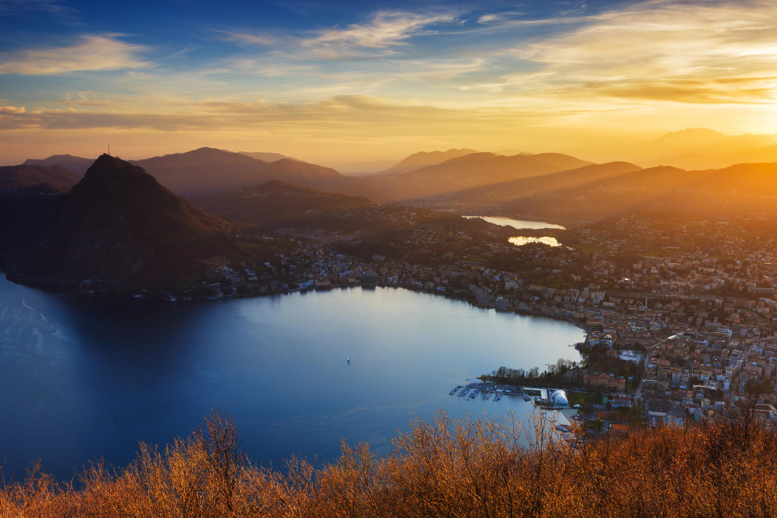 Evening view from Monte Bre (925 m) of Lugano and the San Salvatore (912 m). Copyright by: Switzerland Tourism