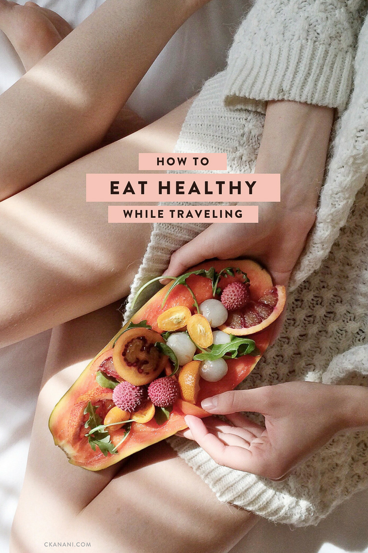 How to eat healthy while traveling to feel happy and full of energy! Tips like what to pack, what to order at restaurants, and more. #health #wellness #travel #healthyeating