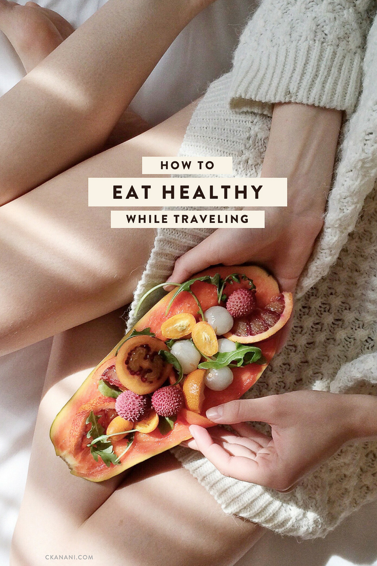 How to eat healthy while traveling to feel happy and full of energy! Tips like what to pack, what to order at restaurants, and more. #health #wellness #travel #healthyeating #fitness