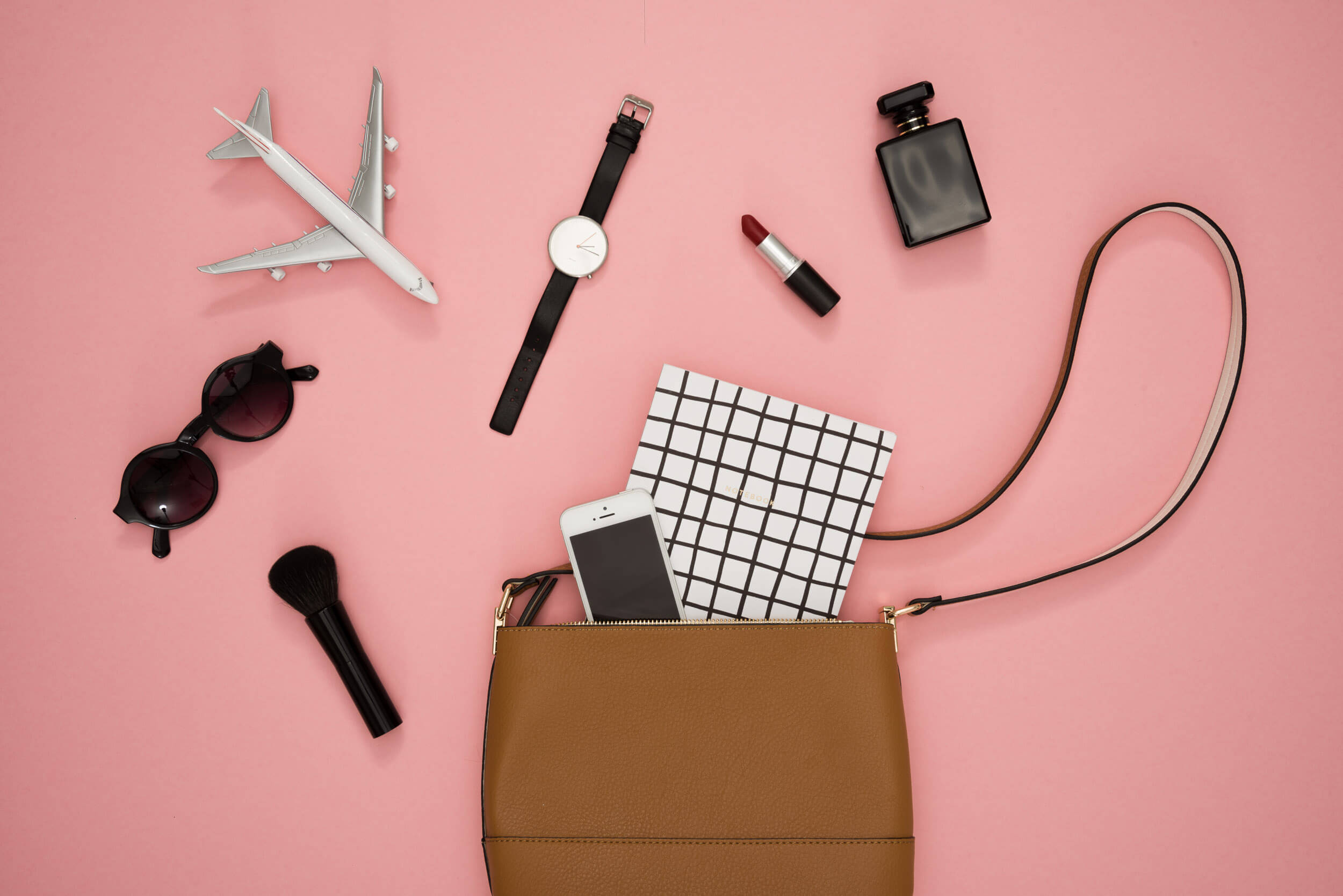 ckanani-female-bag-and-accessories-on-a-pink-background.jpg