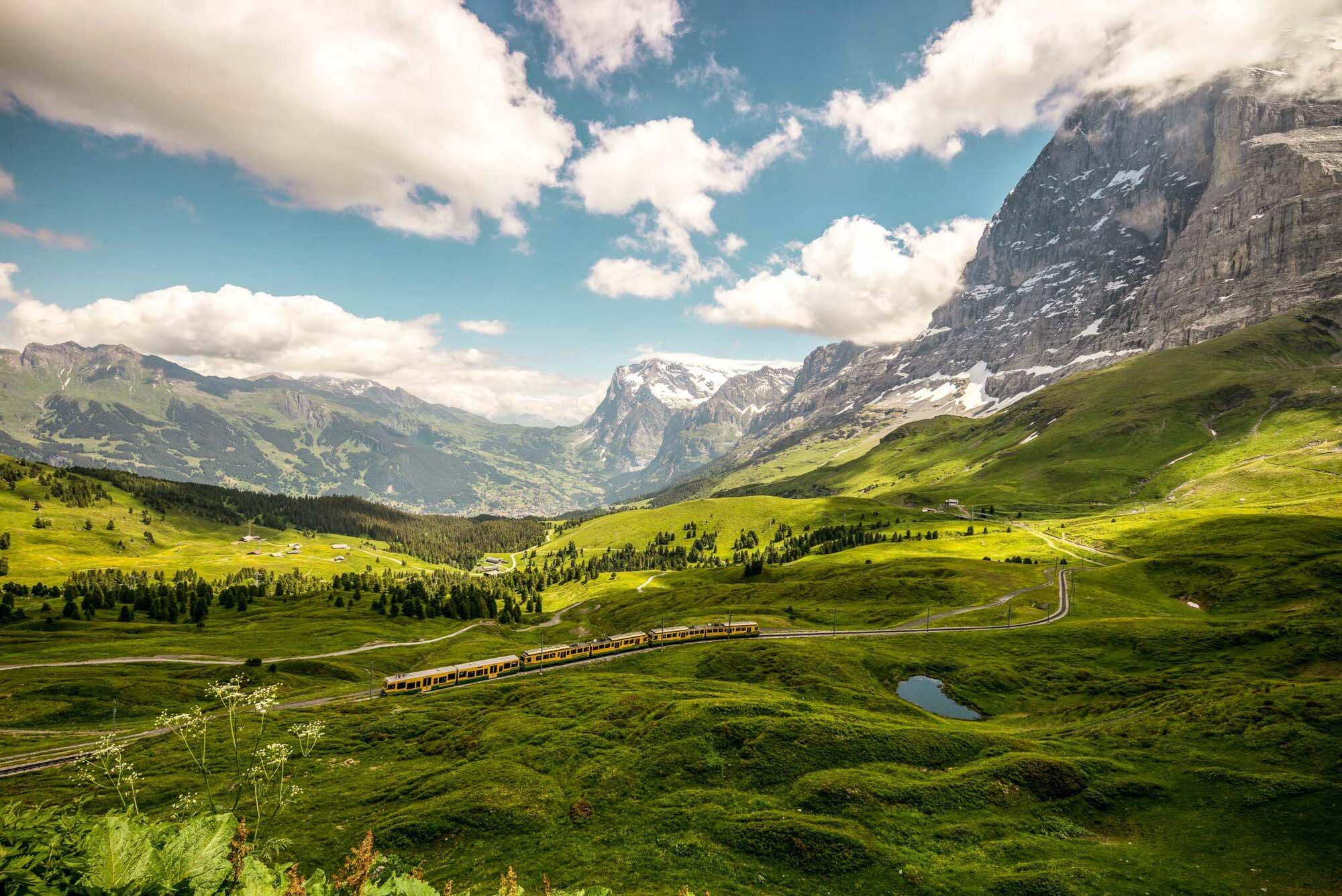 On the Kleine Scheidegg with a view to Grindelwald. The Jungfraubahn in front of the Eiger North Face. Copyright by: Switzerland Tourism