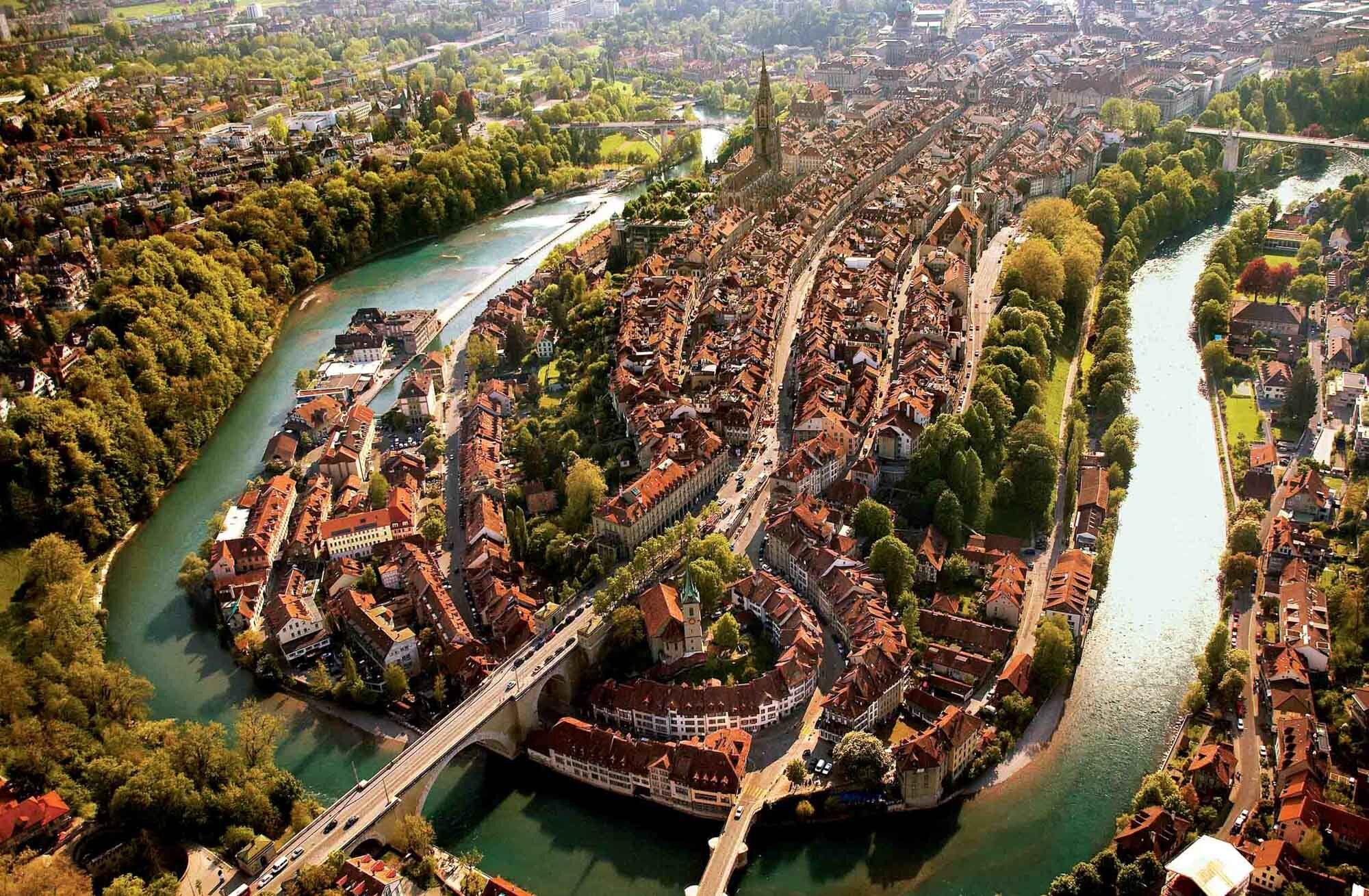 Bern, Switzerland's Federal capital. Aerial photograph of the old town, which is on the UNESCO list of Historic Cities and Towns. Copyright by Switzerland Tourism