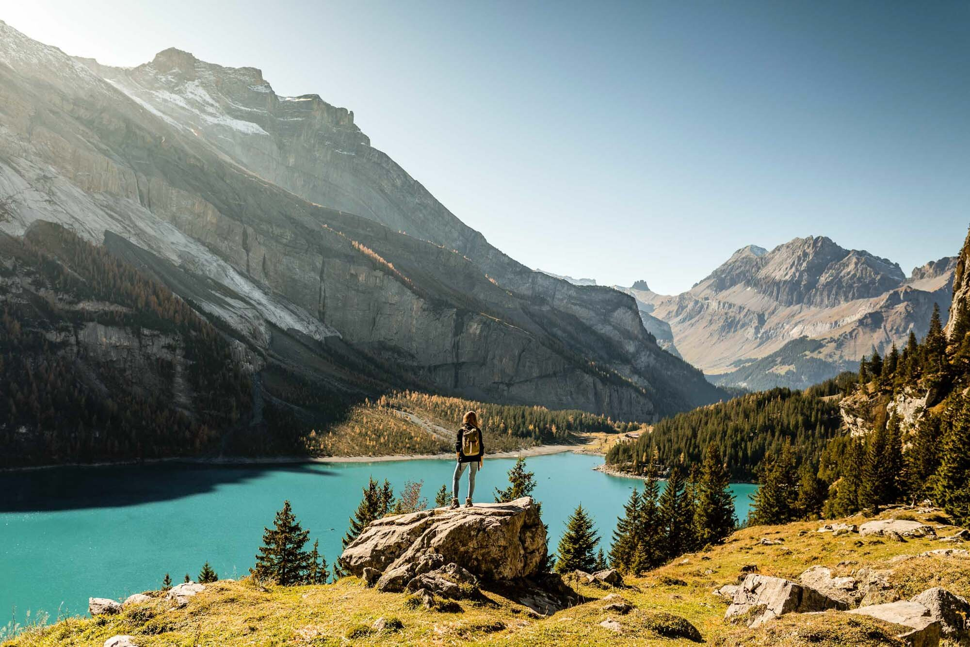 Autumn mood with a hiker at Oeschinensee near Kandersteg. Copyright by: Switzerland Tourism
