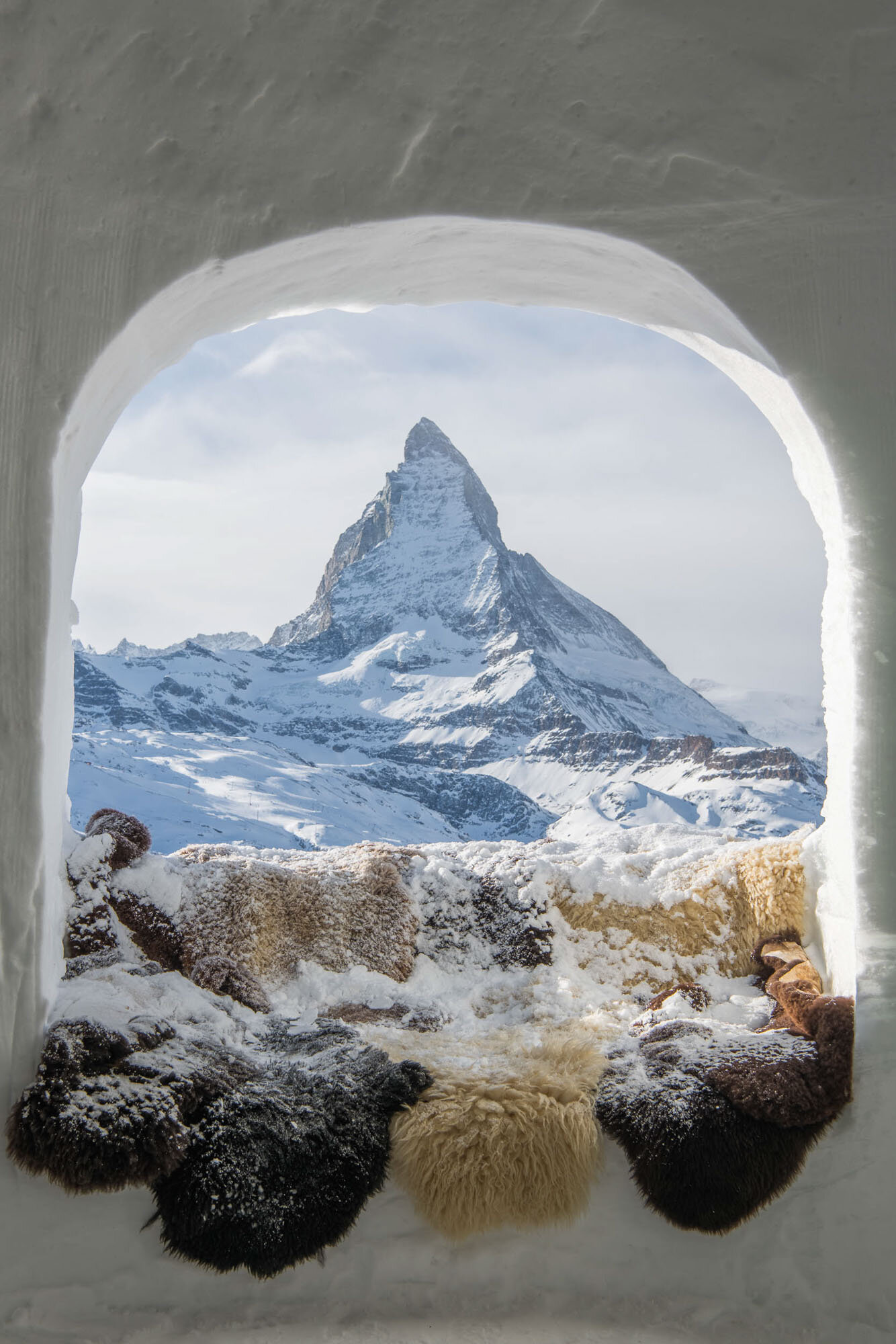 Looking through an igloo window to the Matterhorn. Copyright by: Switzerland Tourism
