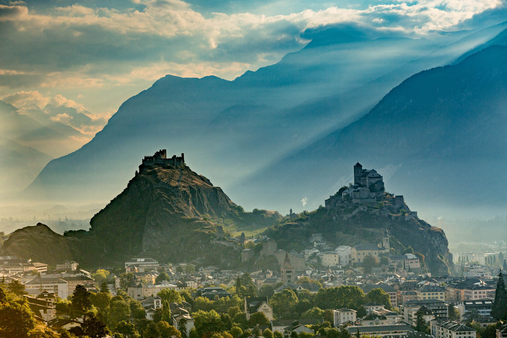 Mystic light mood over the two castles in Sion. Copyright by: Switzerland Tourism