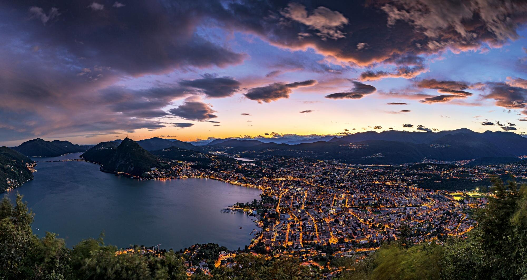 Evening panorama from Monte Bre direction Lugano. Copyright by: Switzerland Tourism