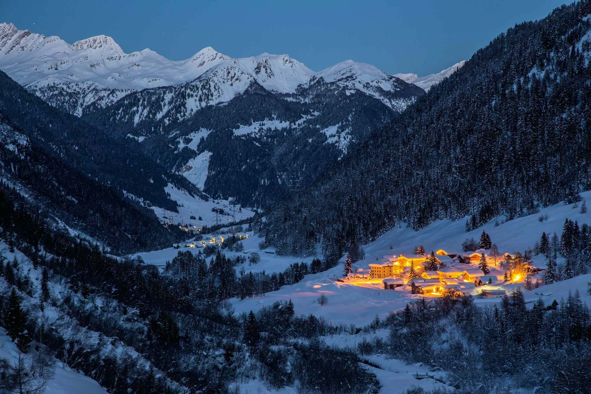 Nightfall over the snowy Ossasco, Bedretto valley. Copyright by: Switzerland Tourism