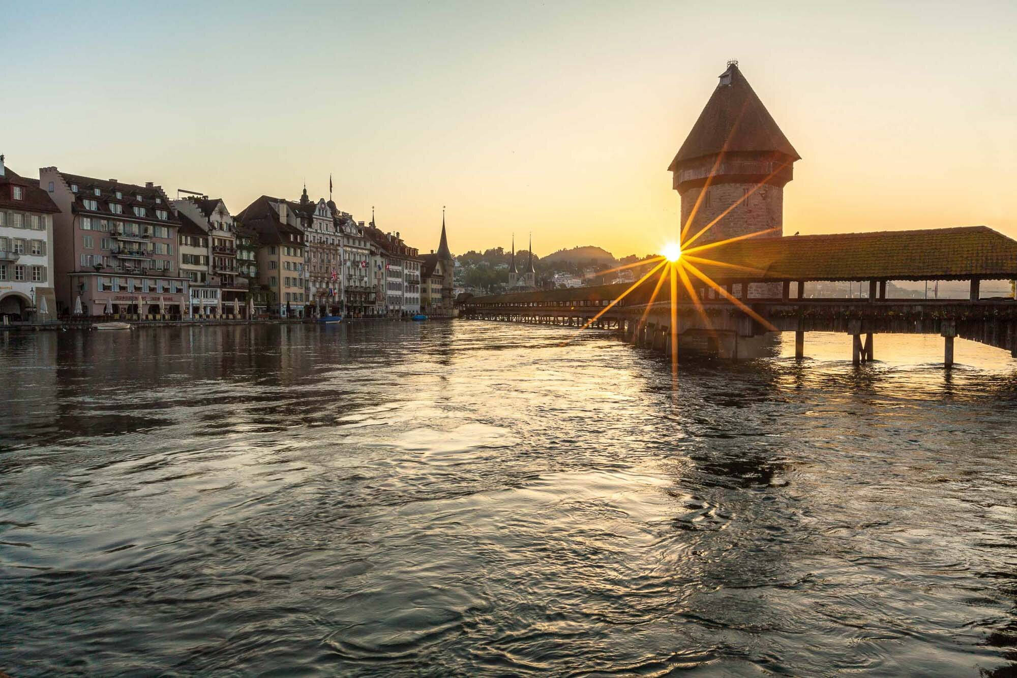 Sunrise over the Kappelbruecke, Lucerne. Copyright by: Switzerland Tourism