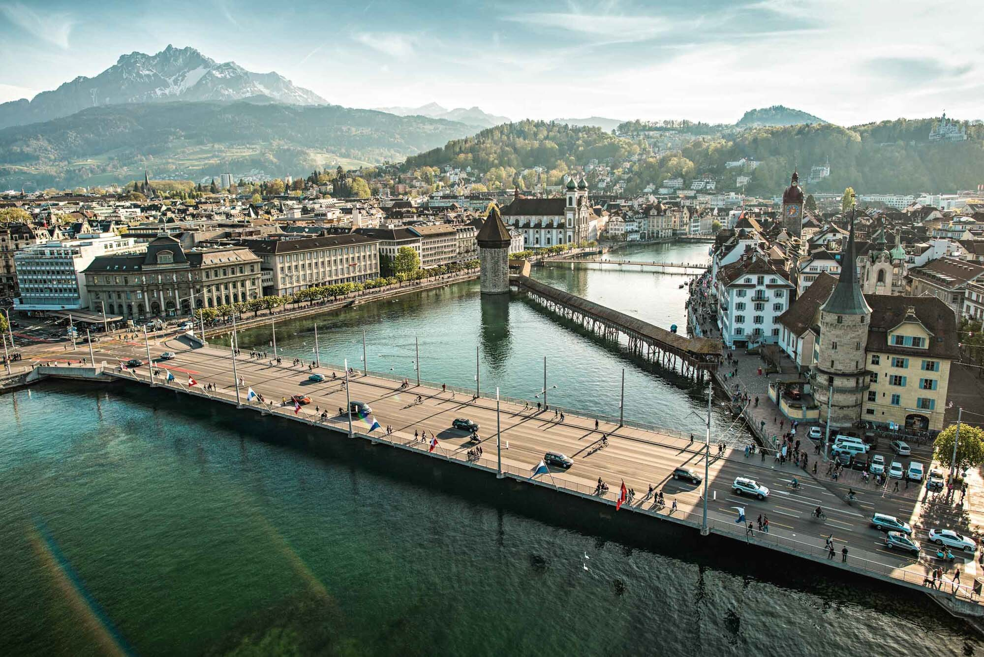 City panorama with Pilatus, Chapel Bridge, and Guetsch. Copyright by: Switzerland Tourism