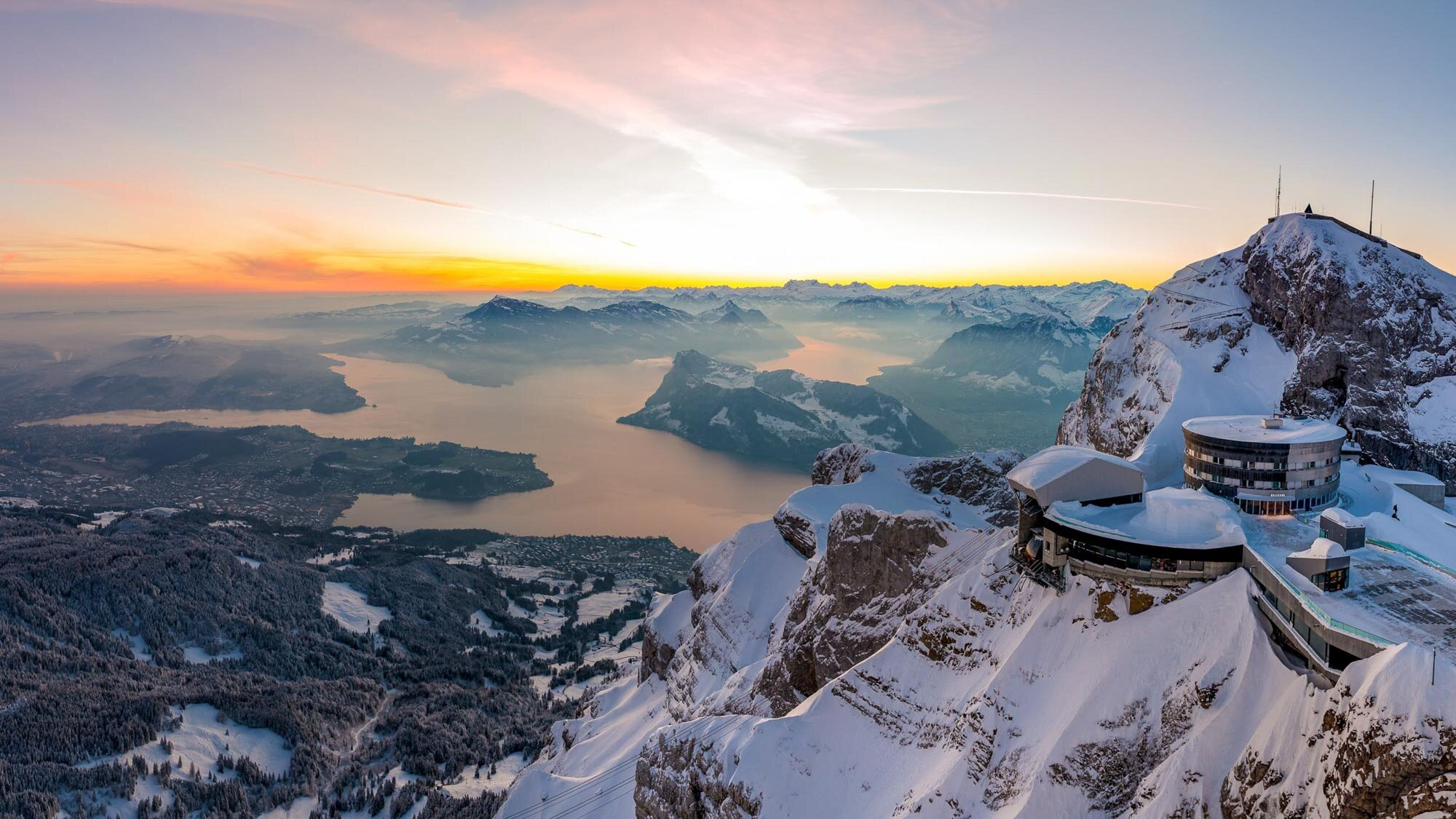 A sunrise on Pilatus Kulm with a view of Lake Lucerne and the Hotel Bellevue. Copyright by Pilatus-Bahnen
